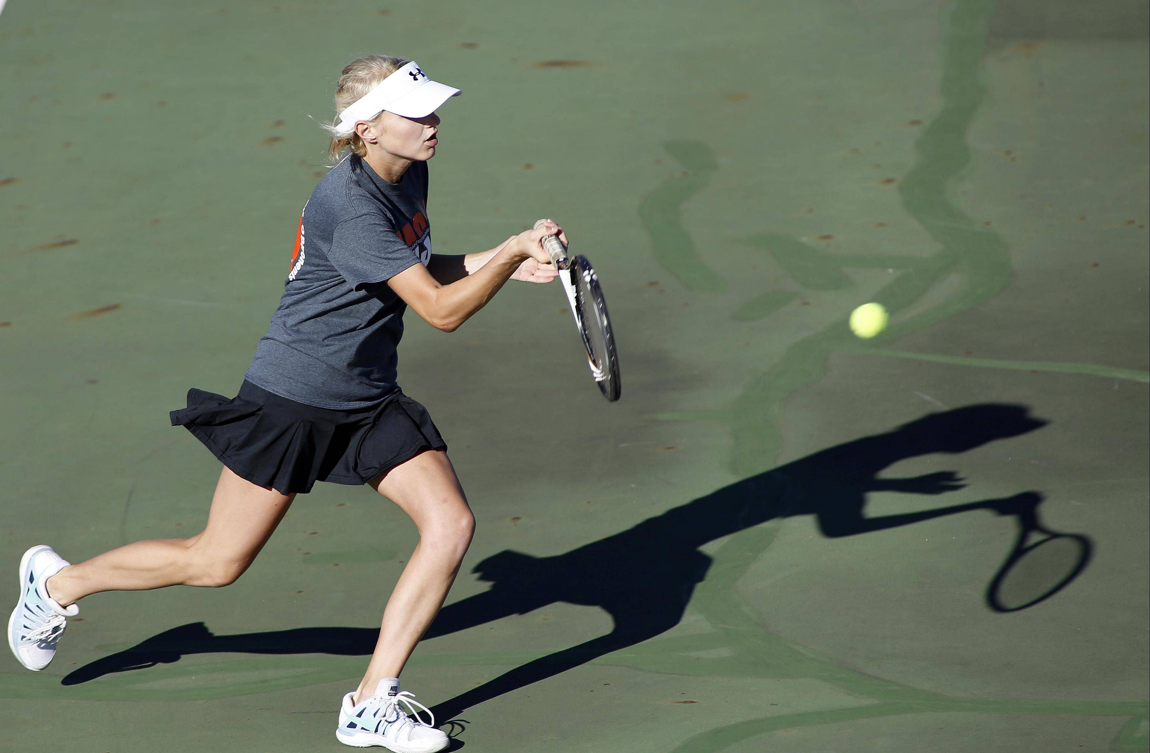 St. Charles East�s No. 1 singles player Sarah Church returns a shot at the Saints� invitational Saturday.
