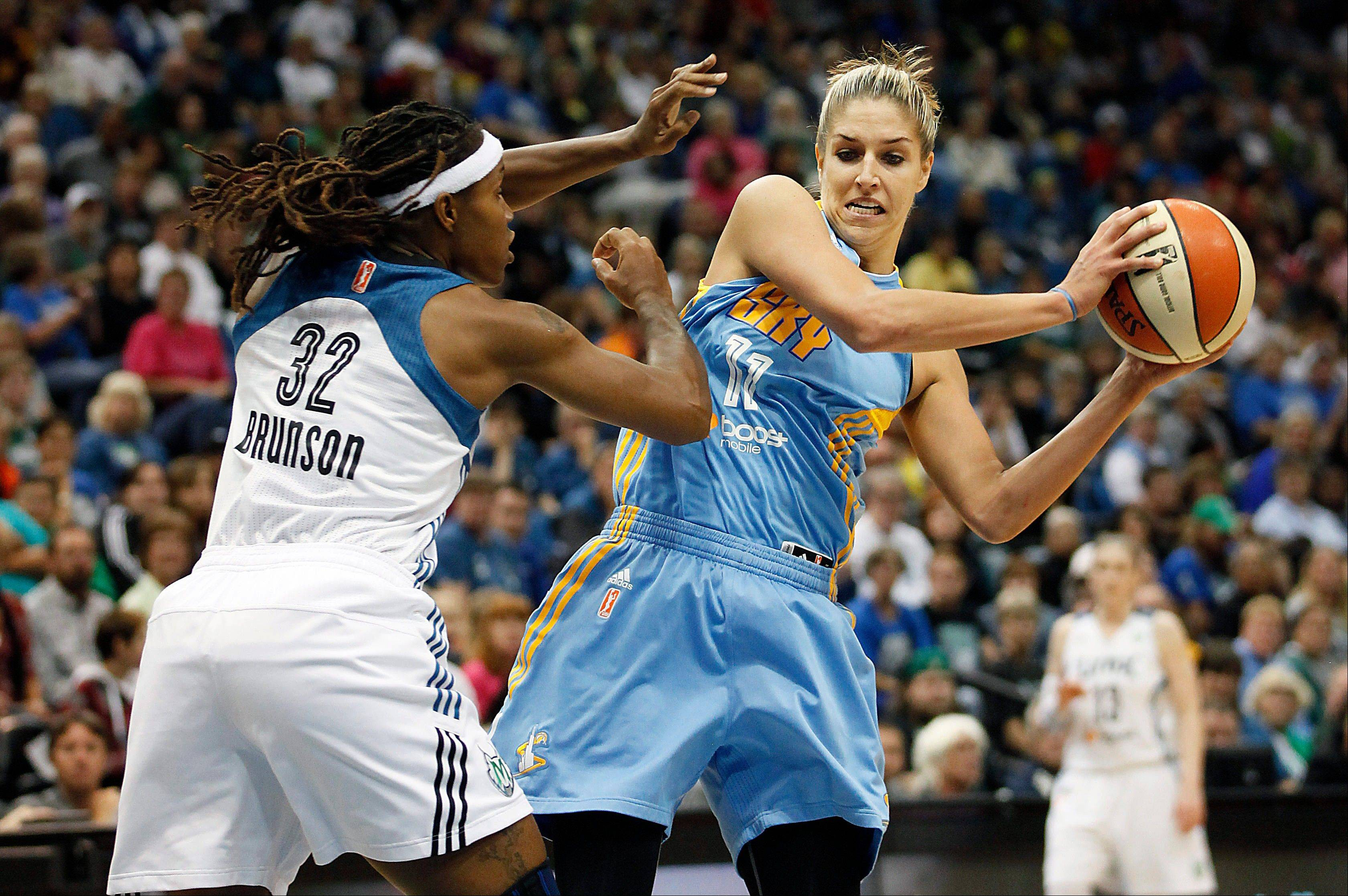 Chicago Sky guard Elena Delle Donne (11) protects the ball against Minnesota Lynx forward Rebekkah Brunson (32) in the first half of a WNBA basketball game, Saturday, Sept. 14, 2013, in Minneapolis.