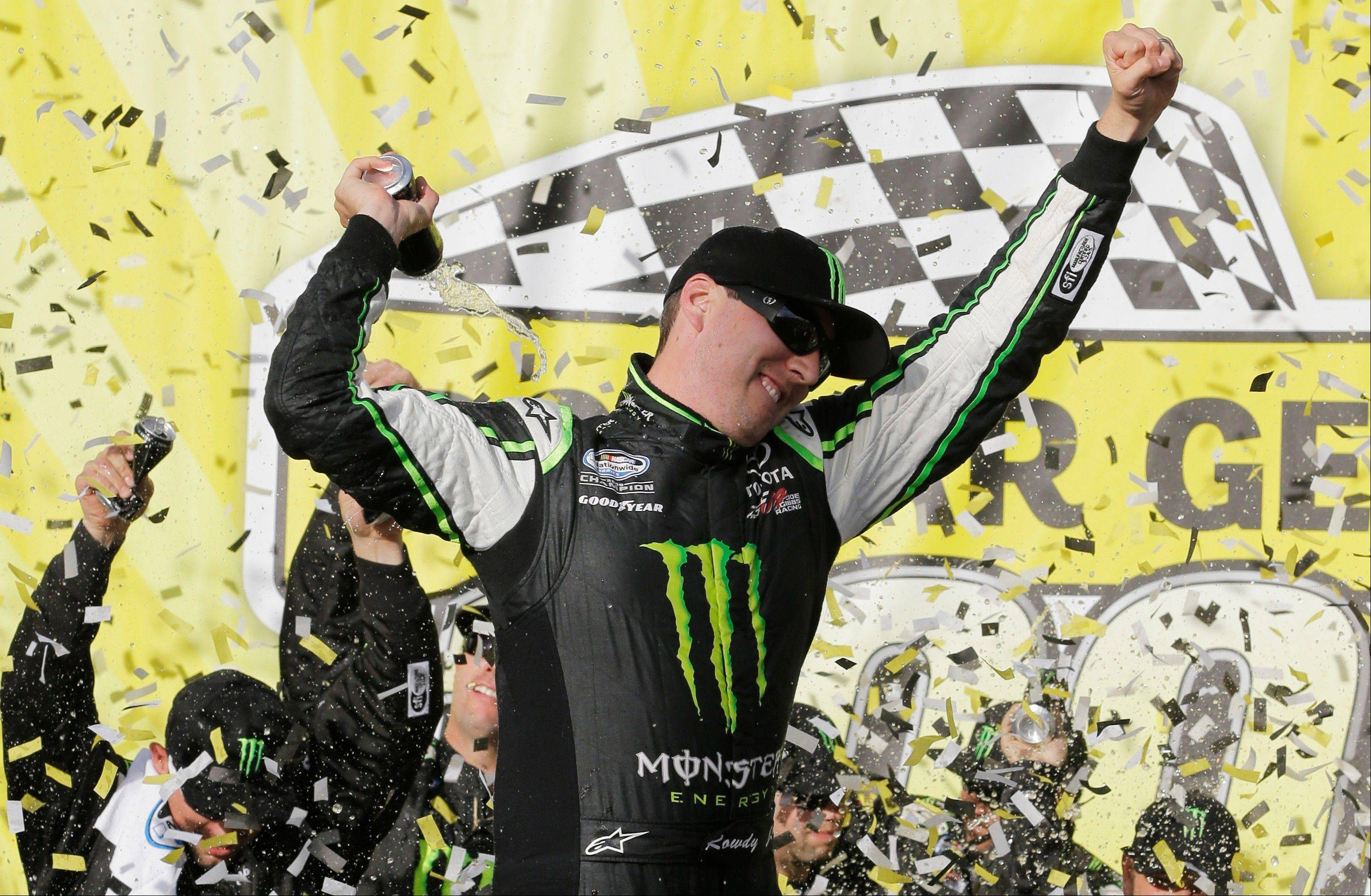Kyle Busch celebrates in Victory Lane after winning the NASCAR Nationwide Series auto race at Chicagoland Speedway in Joliet, Ill., Saturday, Sept. 14, 2013.