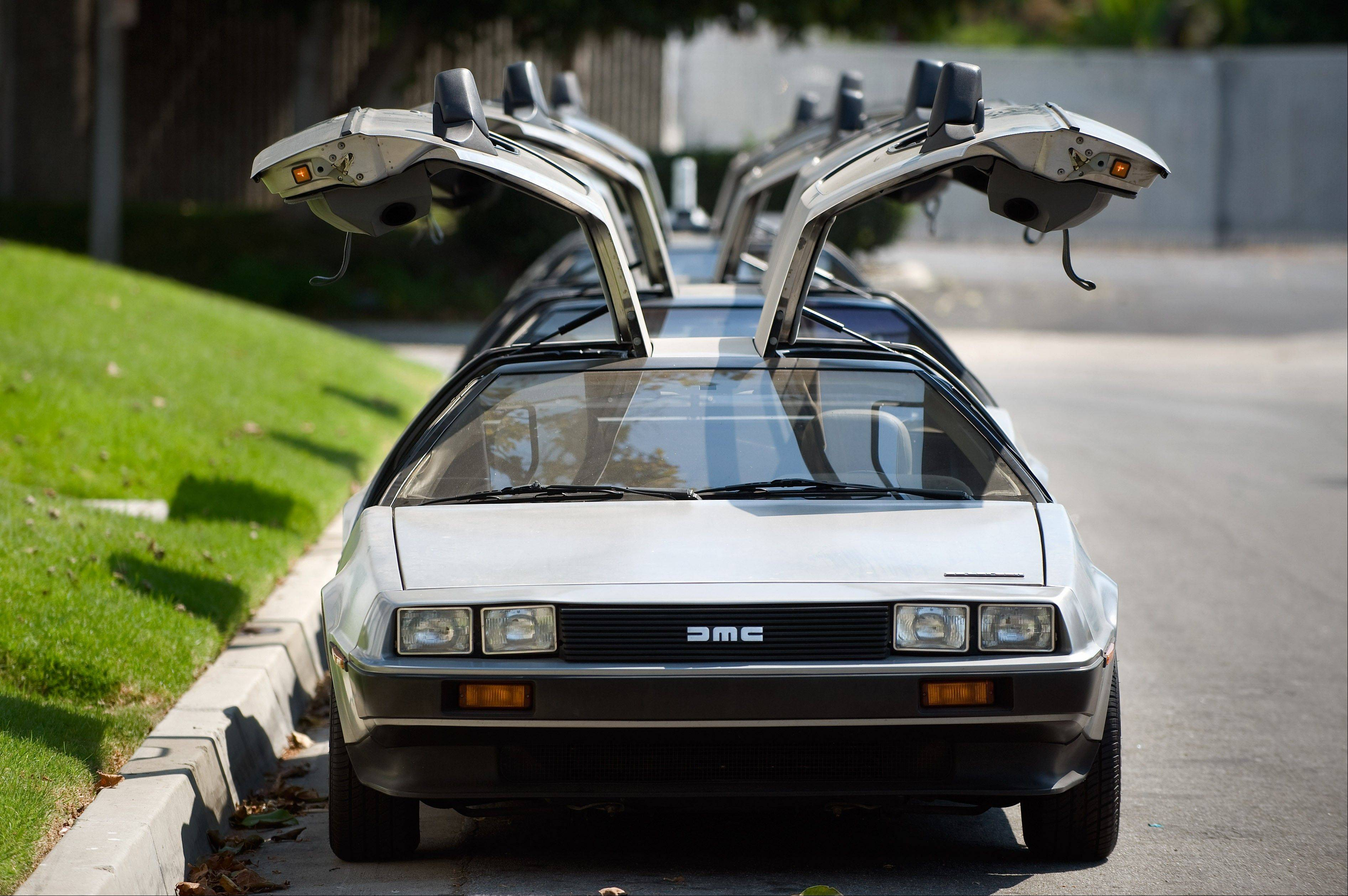 DeLorean cars parked Tuesday outside The DeLorean Motor Company in Huntington Beach, Calif. The cars were made from 1981-83 and were known for their stainless steel body and gull-wing doors.