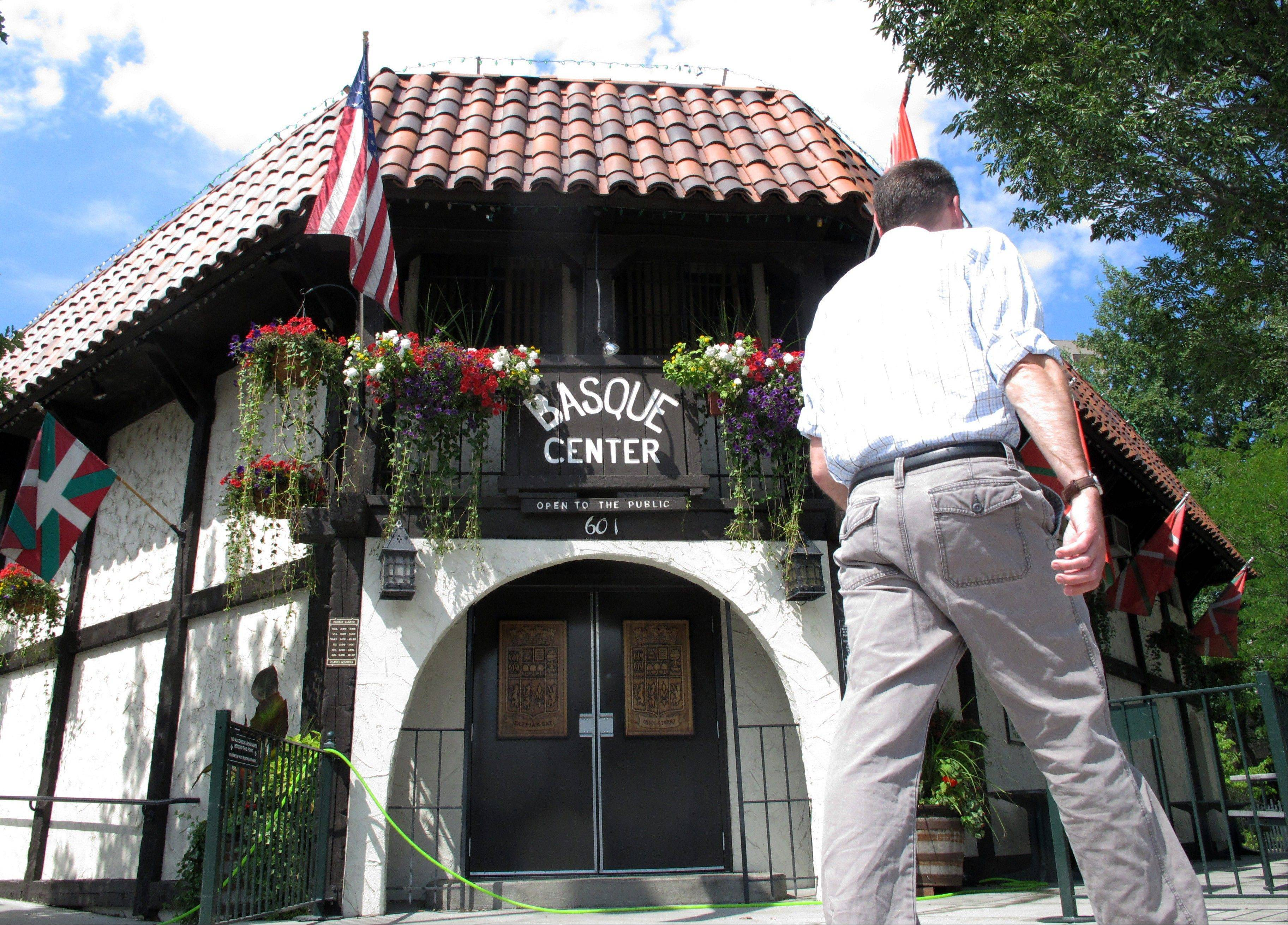 A man walks in front of the Basque Center, which is a gathering place for Boise's Basque community and one of several stops in the city's downtown Basque Block.