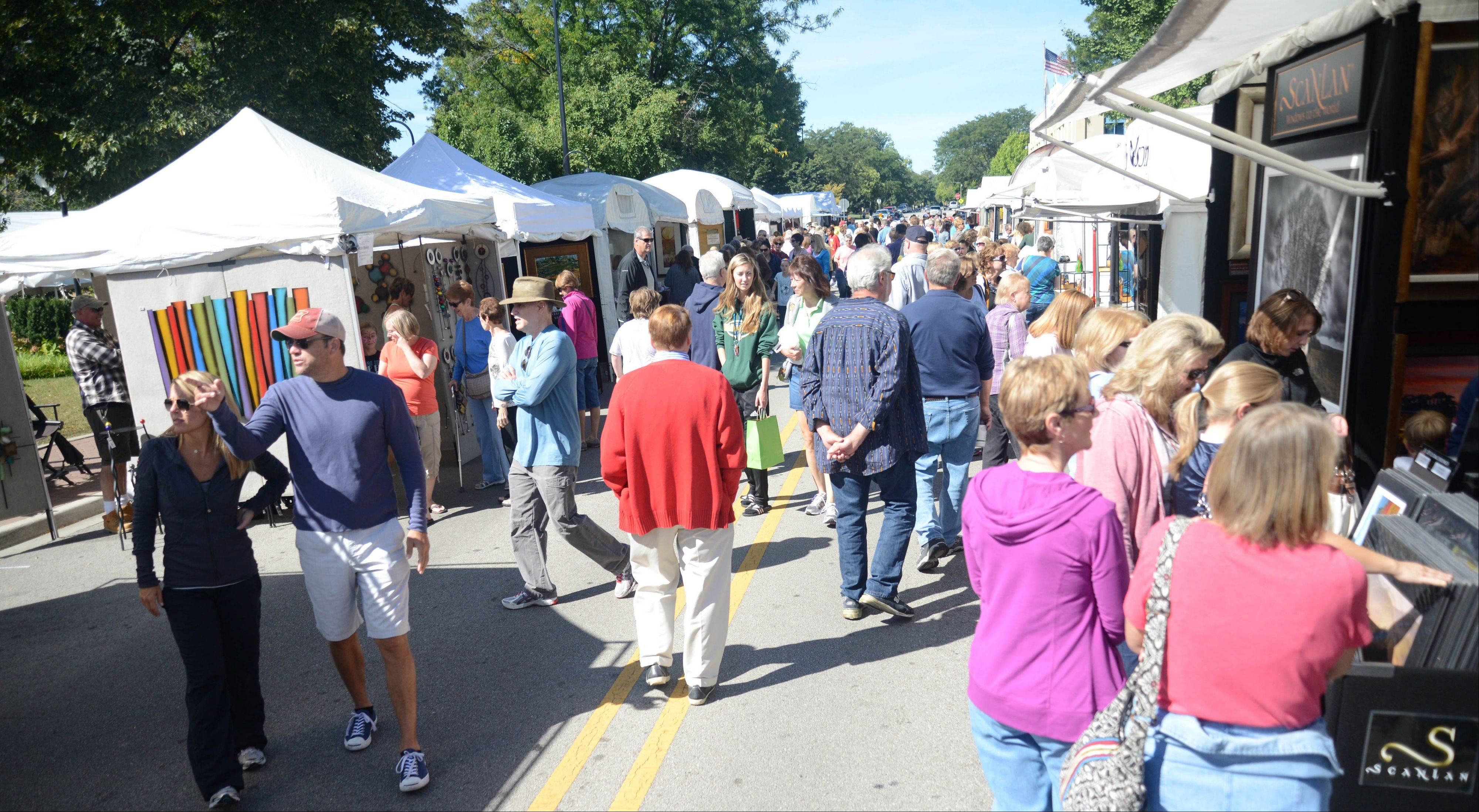 The Naperville Art League's annual Riverwalk Fine Art Fair in Naperville brought lots of people on Saturday to downtown Naperville. The fair features works by 135 artists.