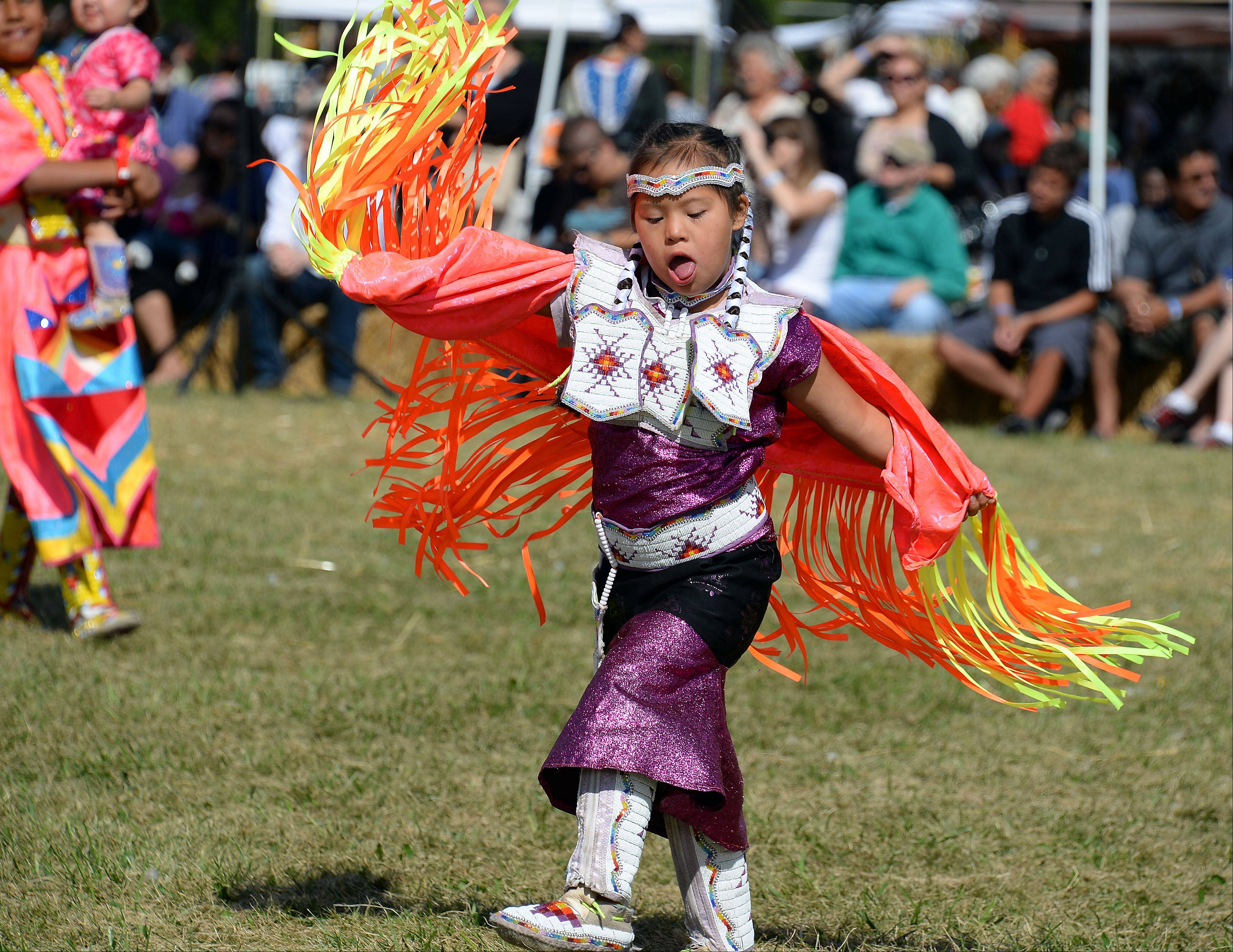 Jackie Cleveland , 7, from the HoChunk Nation in Wisconsin dances in the tiny tots dance for the people Saturday at the 60th annual Chicago Pow Wow at Busse Woods.