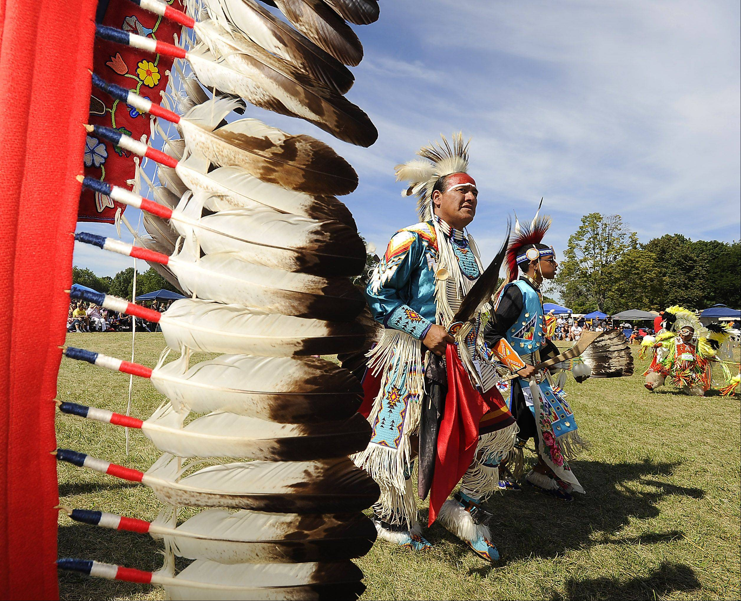 Charles Hindsley and D. J. Scott from the HoChunk Nation in Wisconsin dances for the people Saturday at the 60th annual Chicago Pow Wow at Busse Woods.