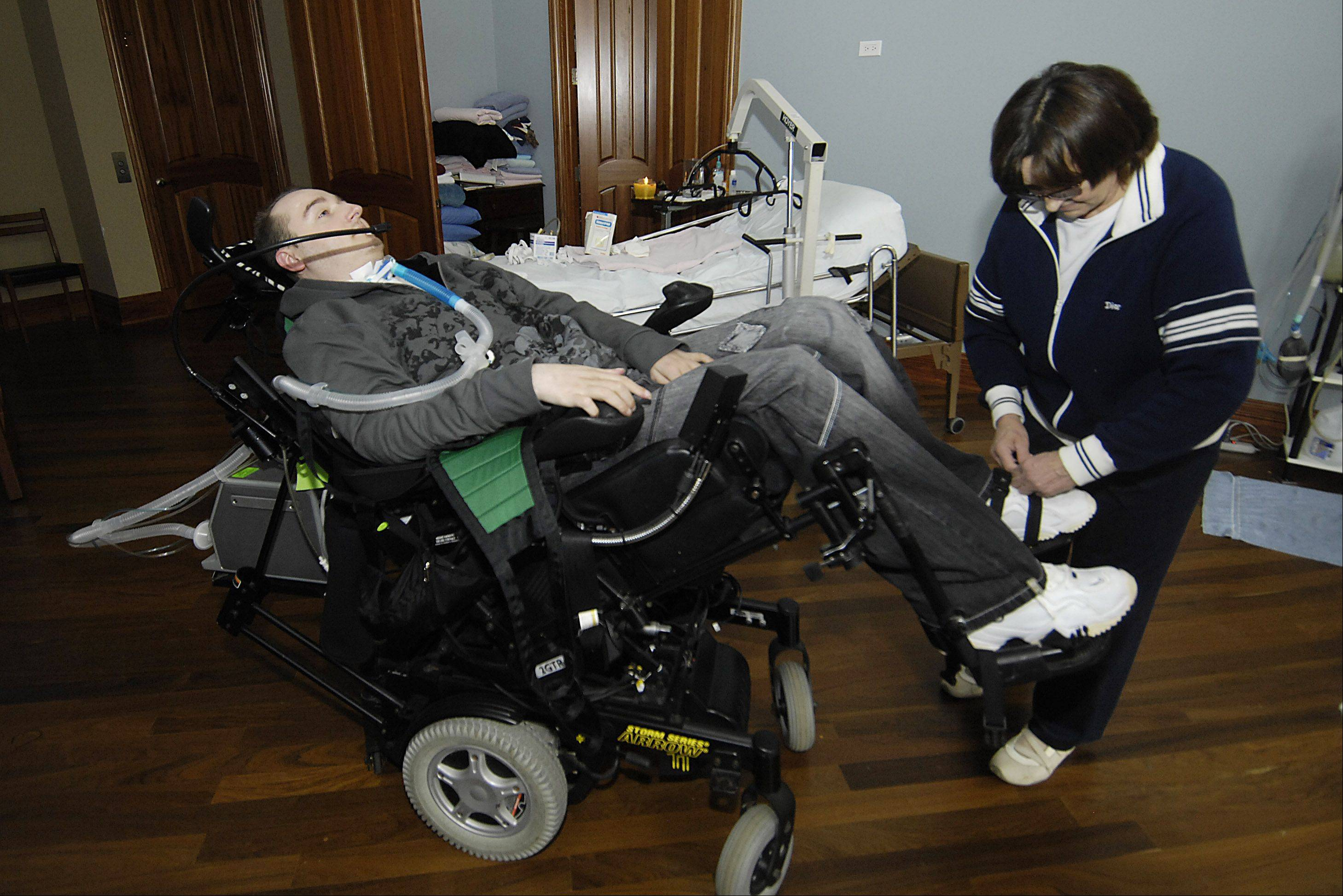 The Gridiron Alliance charity, founded in the wake of Rob Komosa's catastrophic injury during a Rolling Meadows High School football practice, is trying to find a new home for Komosa's high-tech wheelchairs and van. Komosa, being strapped into his wheelchair here by his mother, Barbara, in 2009, died on March 16 of breathing complications.