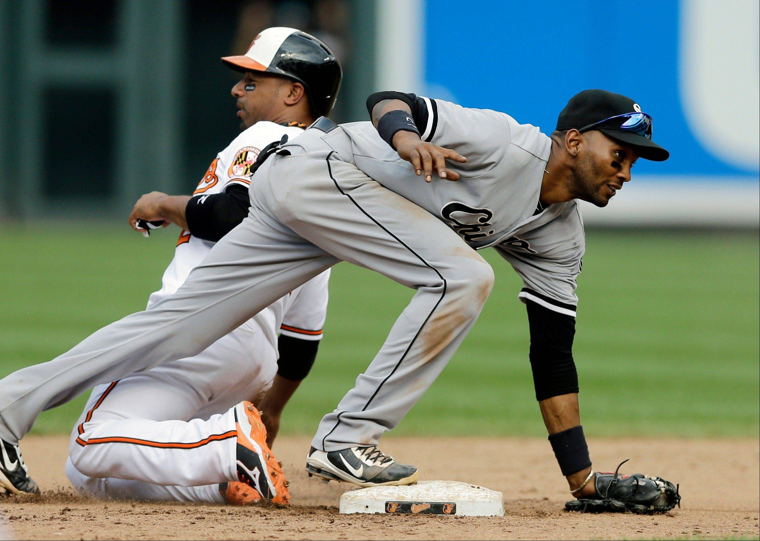 Chicago White Sox shortstop Alexei Ramirez, front, keeps his balance after forcing out Baltimore Orioles' Alexi Casilla at second base on a ground ball by Ryan Flaherty on Sept. 8.