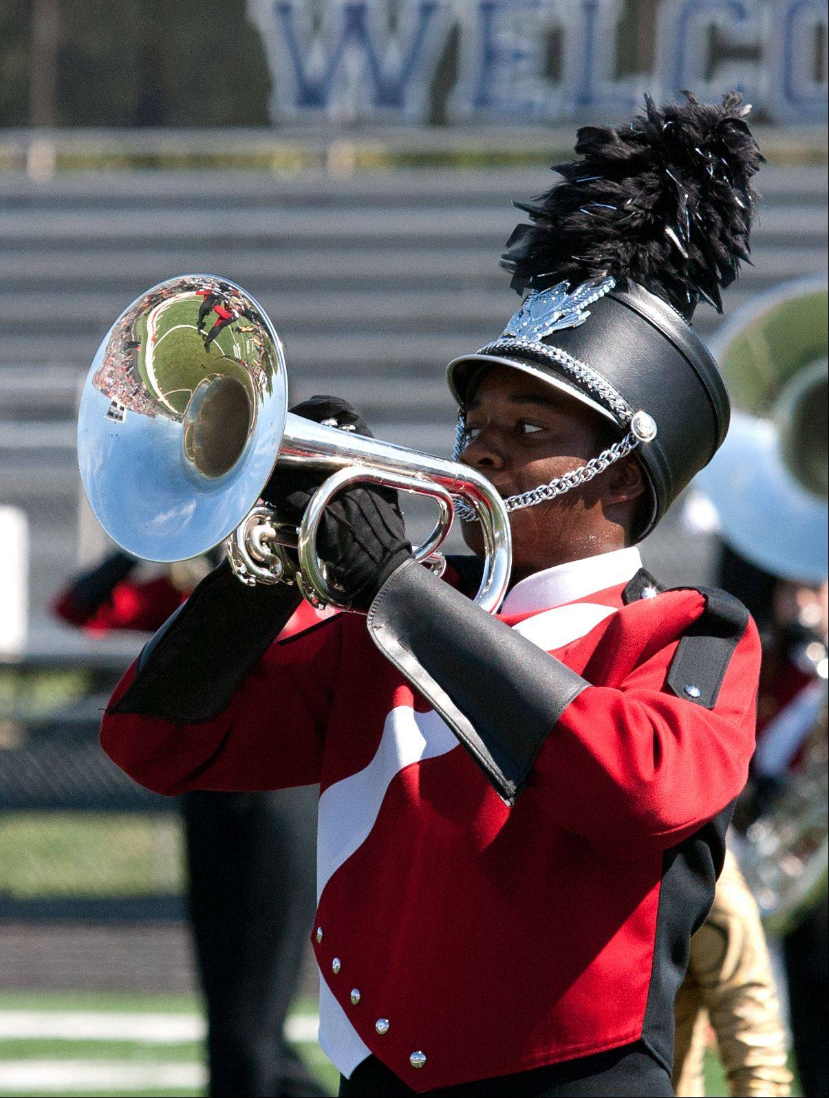 Naperville Central High School Marching Band member Bryson Wilks plays the Mellophone on Saturday during the 35th annual Lancer Joust Marching Band Competition.