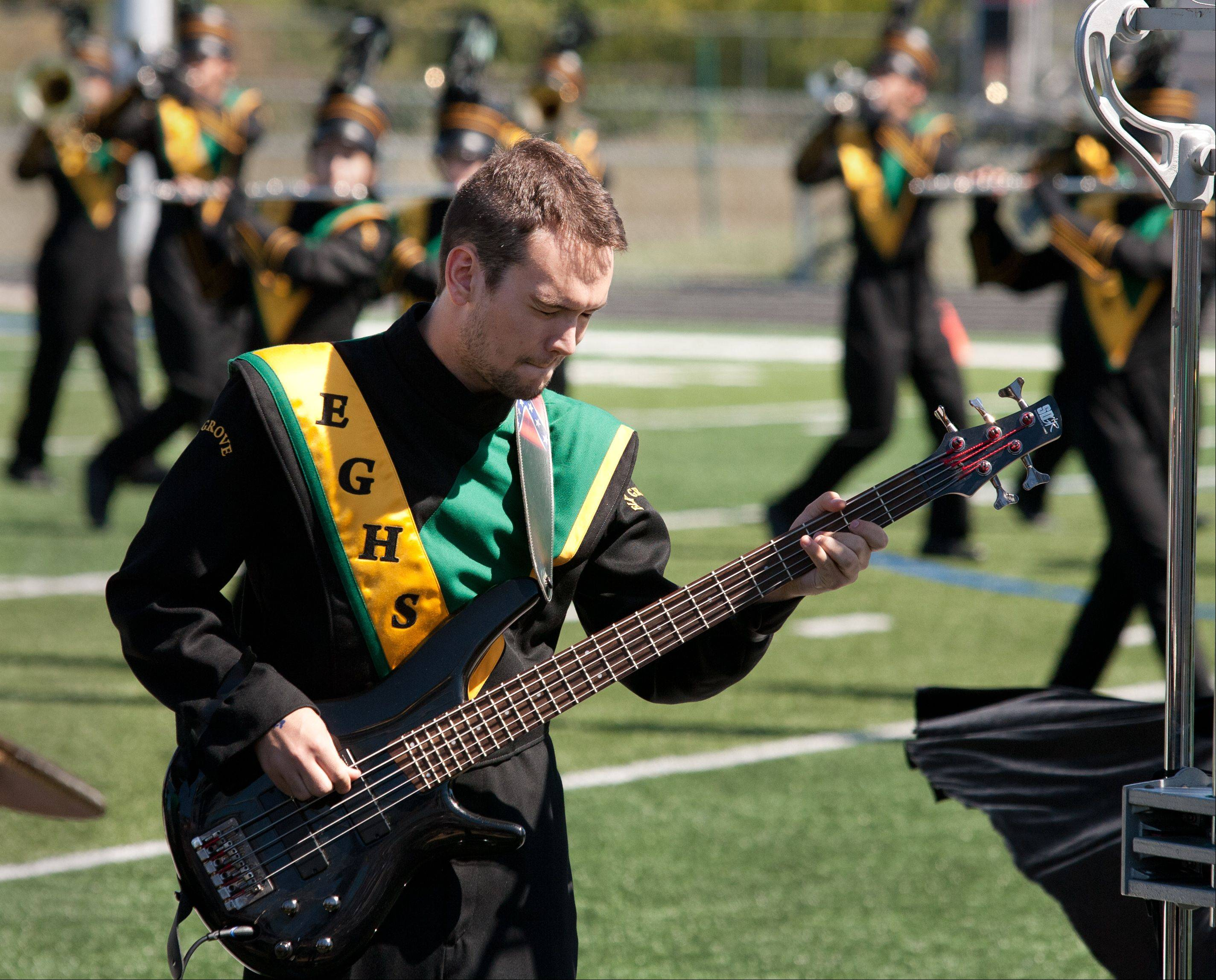 Elk Grove High School Marching Band member Jesse Sneath plays the bass Saturday during the 35th annual Lancer Joust Marching Band Competition.