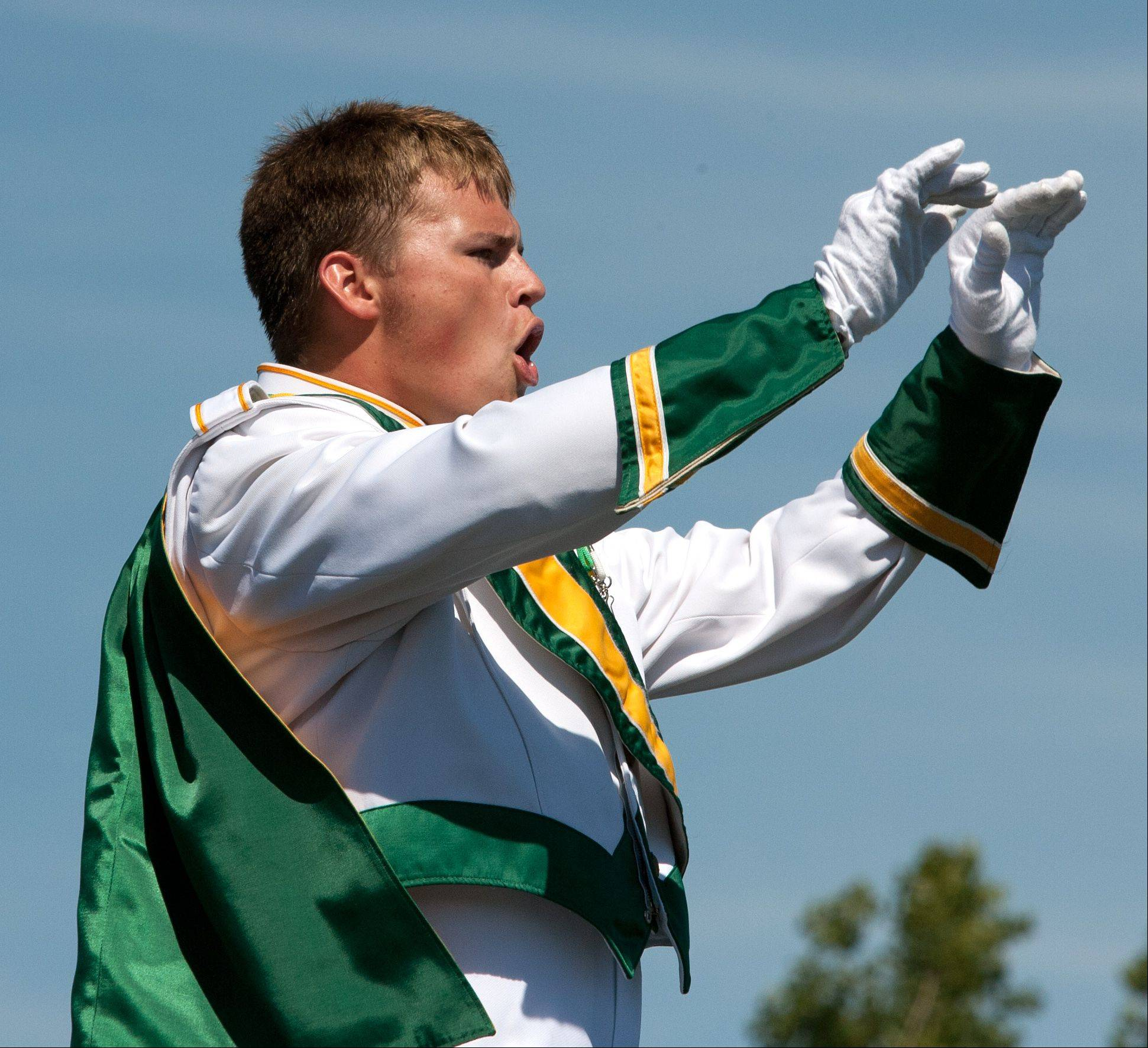 Waubonsie Valley High School Drum Major James O'Neill leads a marching band performance Saturday during the 35th annual Lancer Joust Marching Band Competition.