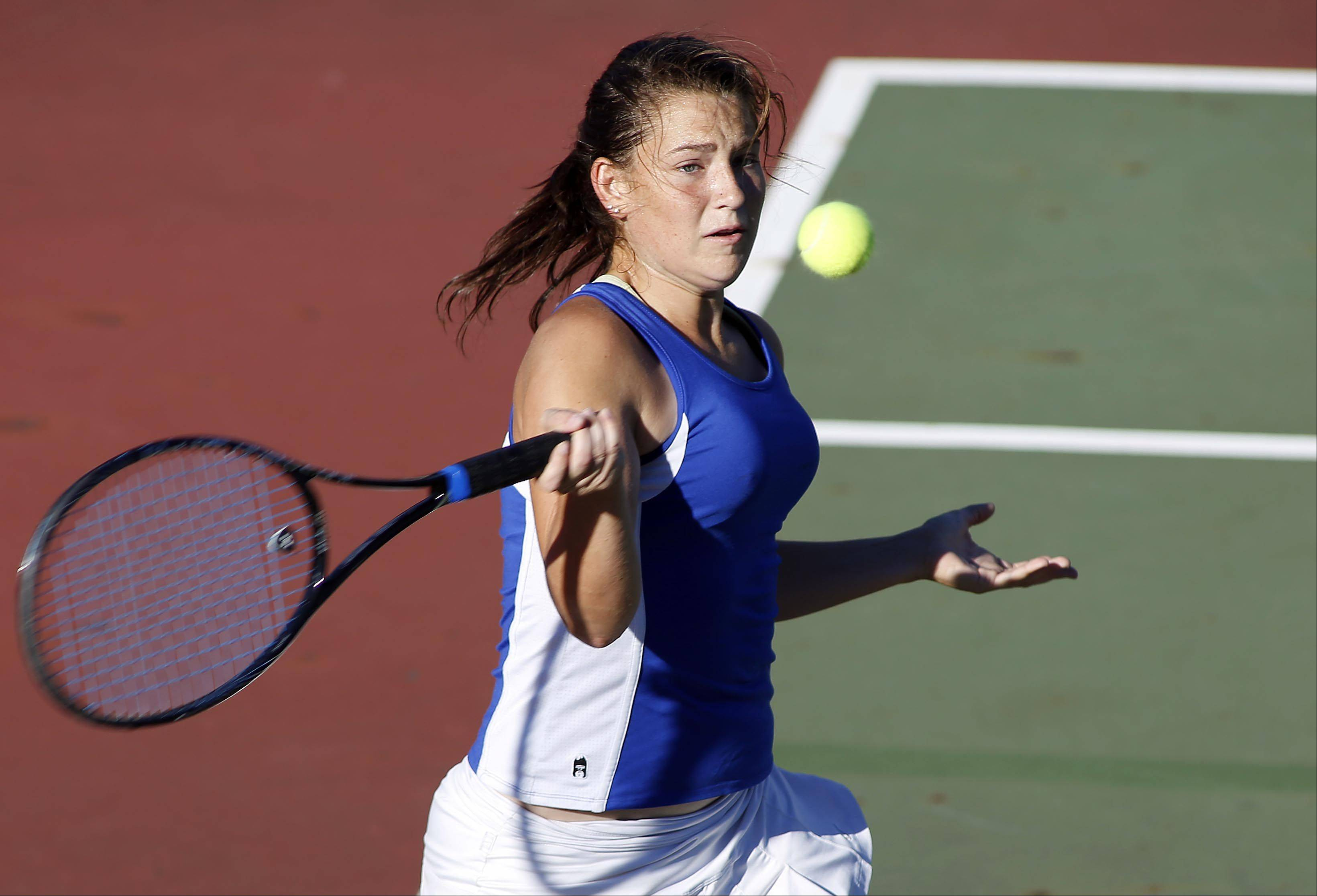 First singles player Kirby Einck of Geneva during the St. Charles East girls tennis invite Saturday.