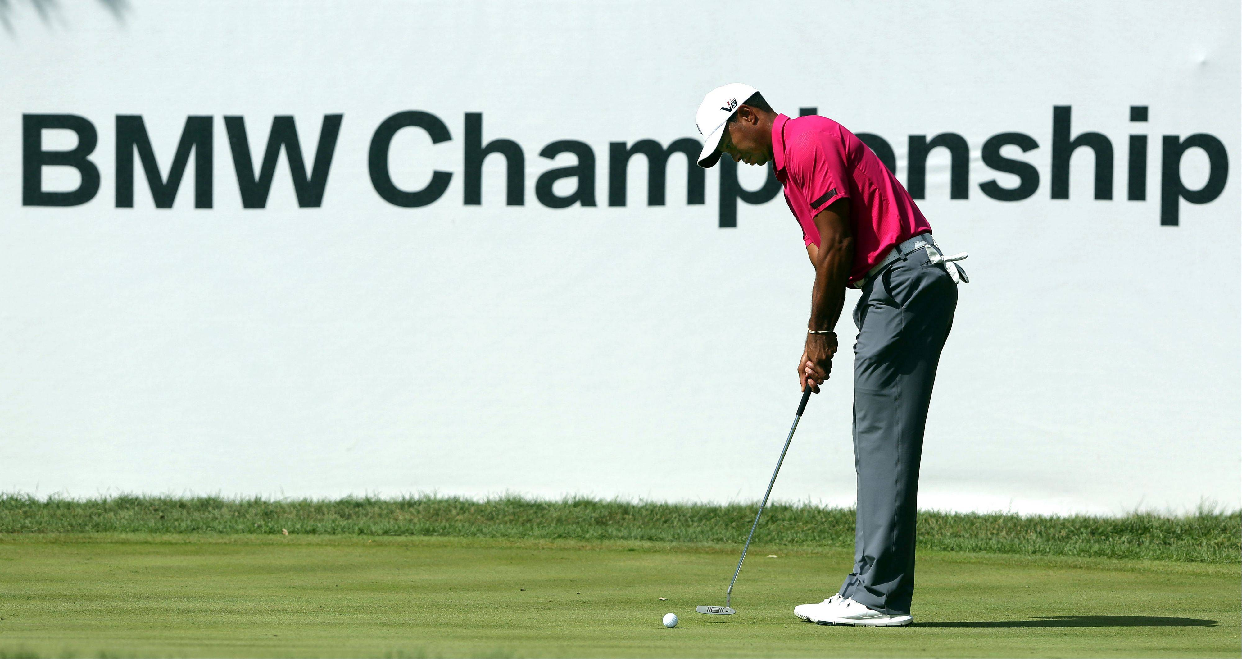 Tiger Woods putts on the ninth hole during the third-round of the BMW Championship at Conway Farms Golf Club in Lake Forest Saturday.