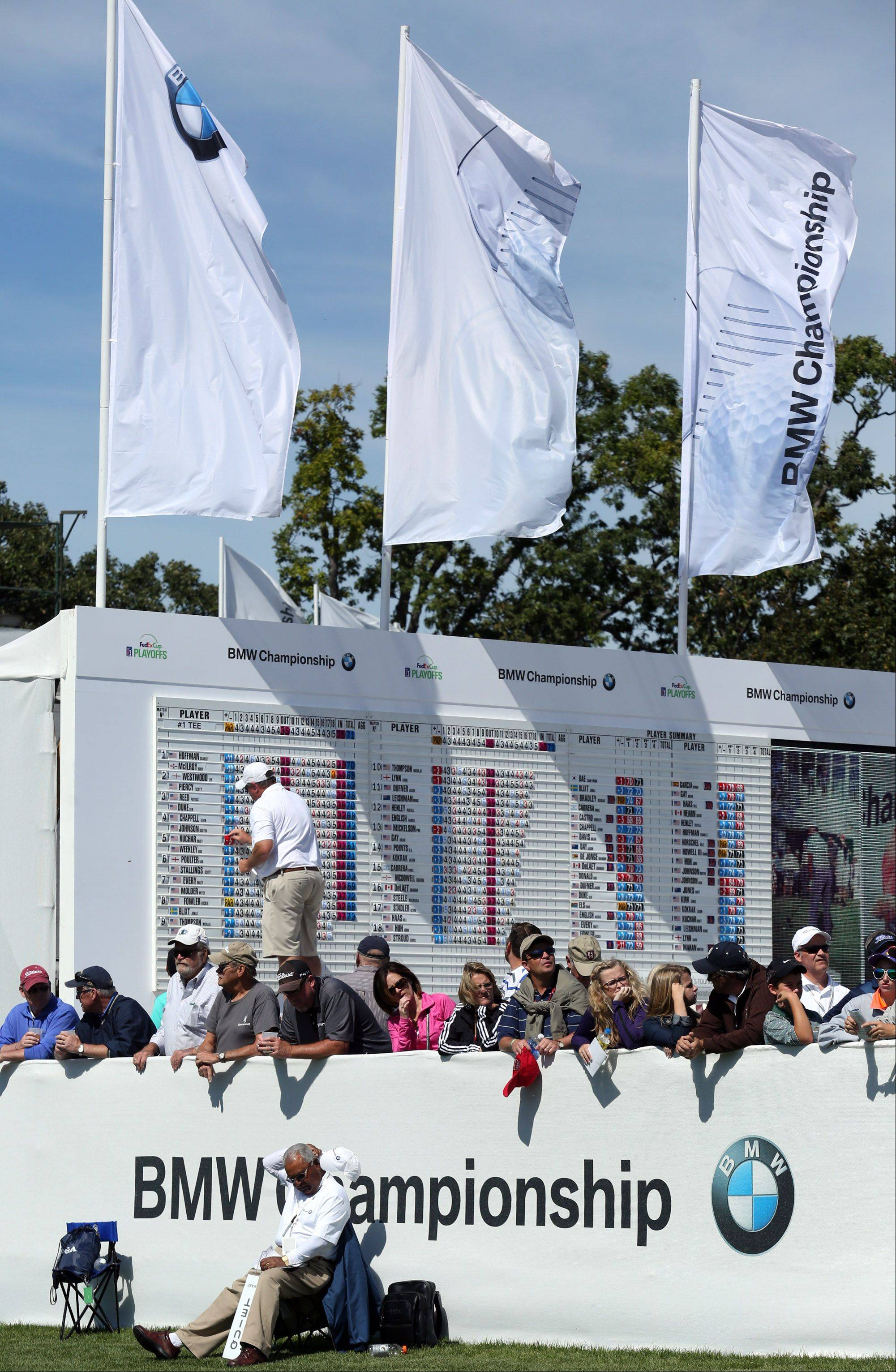 The leader board is adjust after half a day of play during the third-round of the BMW Championship at Conway Farms Golf Club in Lake Forest on Friday.