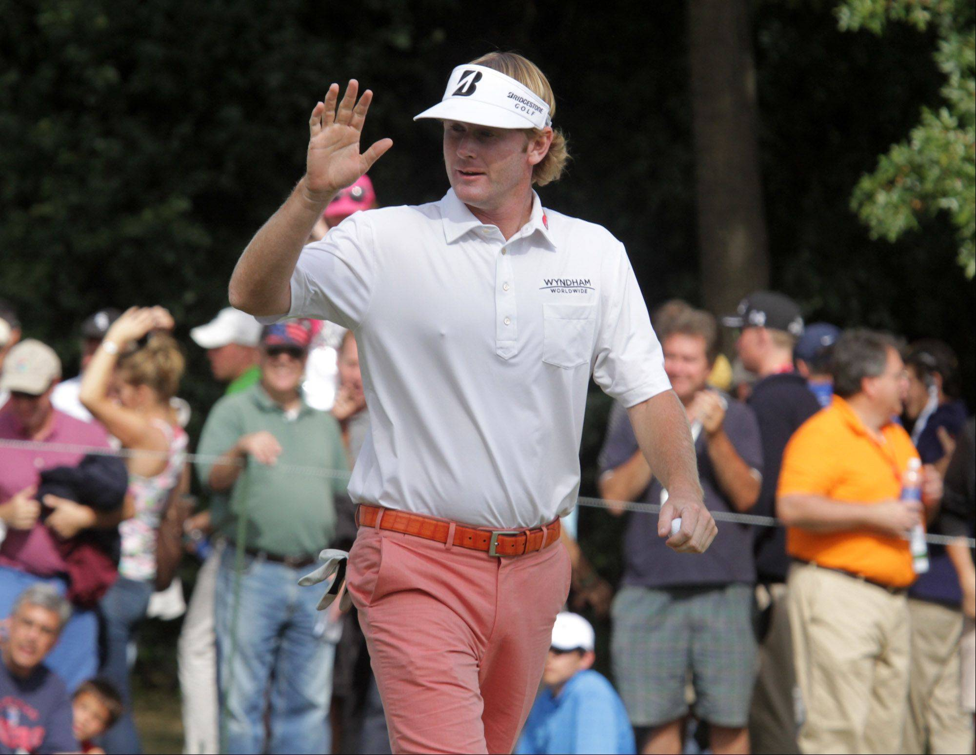 Brandt Snedeker acknowledges the crowd's cheers after sinking a putt on the eight hole during the third-round of the BMW Championship at Conway Farms Golf Club in Lake Forest on Friday.