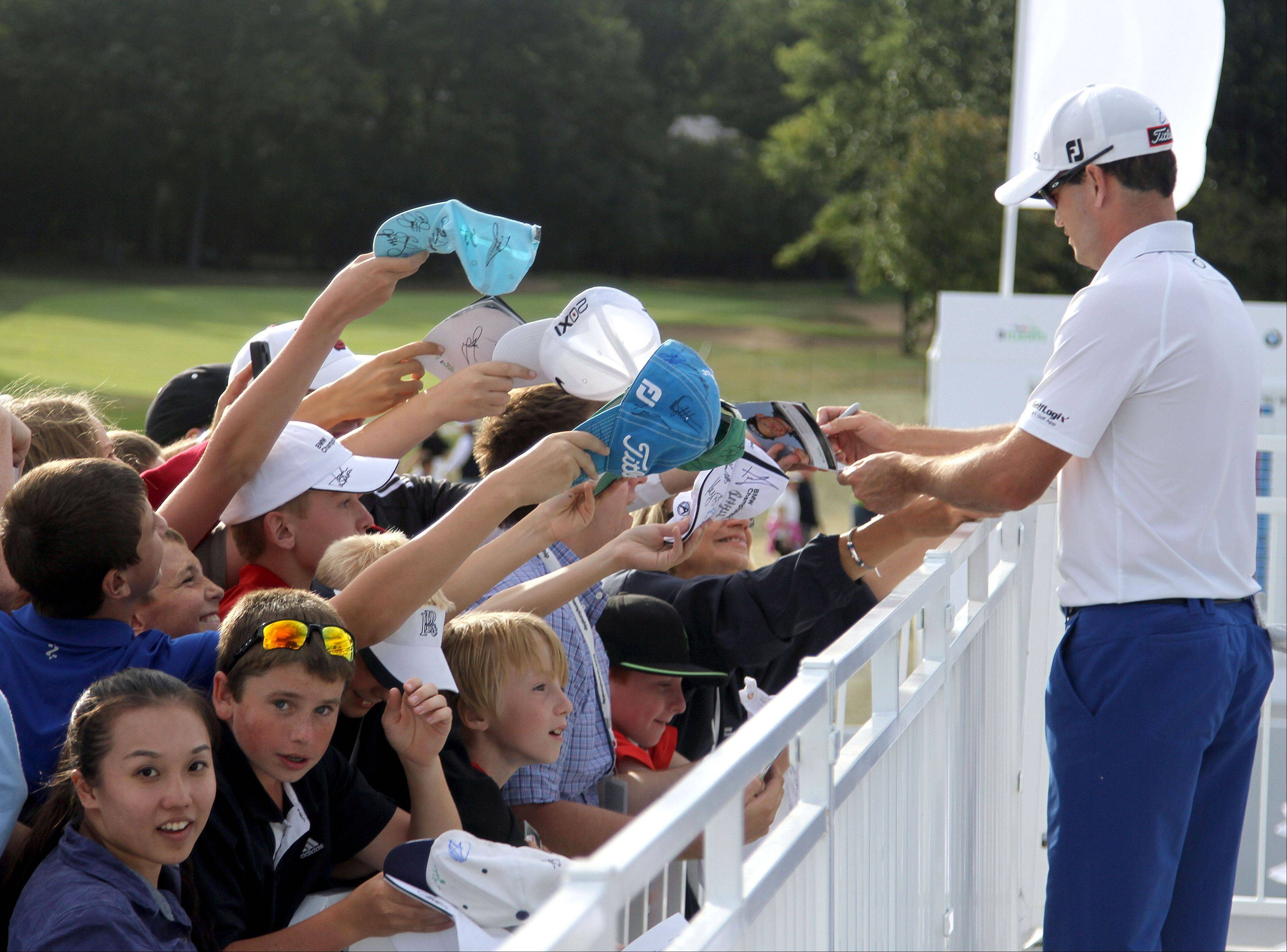 Zach Johnson signs autographs after his round during the third-round of the BMW Championship at Conway Farms Golf Club in Lake Forest Saturday.