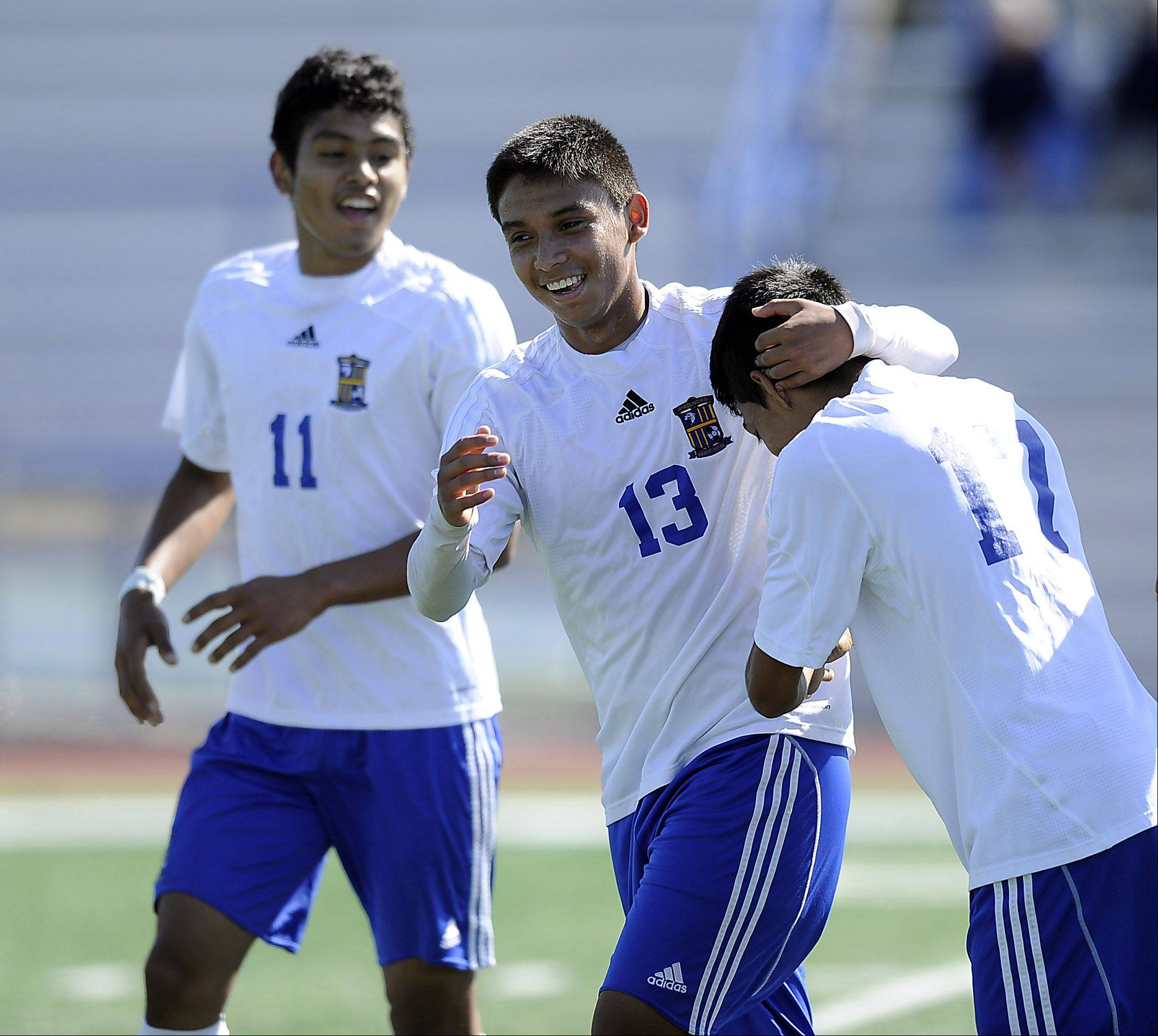 Wheeling's Luis Herrera, Jose Garcia and Fabian Acosta celebrate a goal in the first period at Wheeling on Saturday.