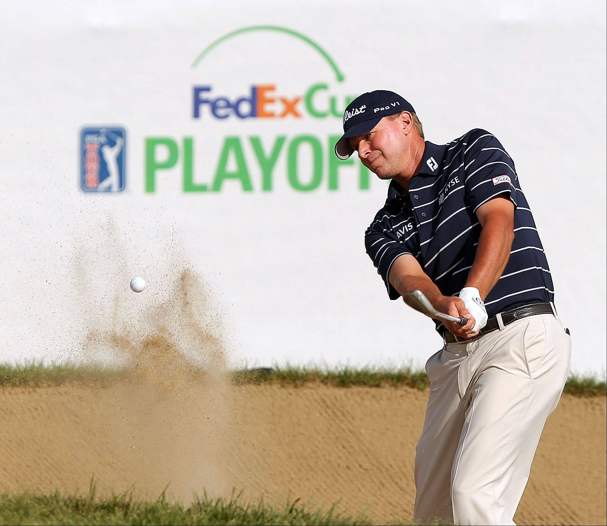 Steve Stricker hits from the sand on the 18th hole during the third-round of the BMW Championship at Conway Farms Golf Club in Lake Forest on Saturday.
