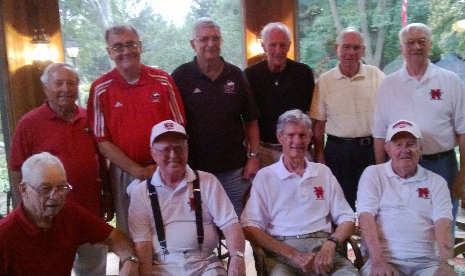 Distinguished Northern Illinois University members, including baseball players from the conference championship teams in 1950-51, pose during a reunion this past week.