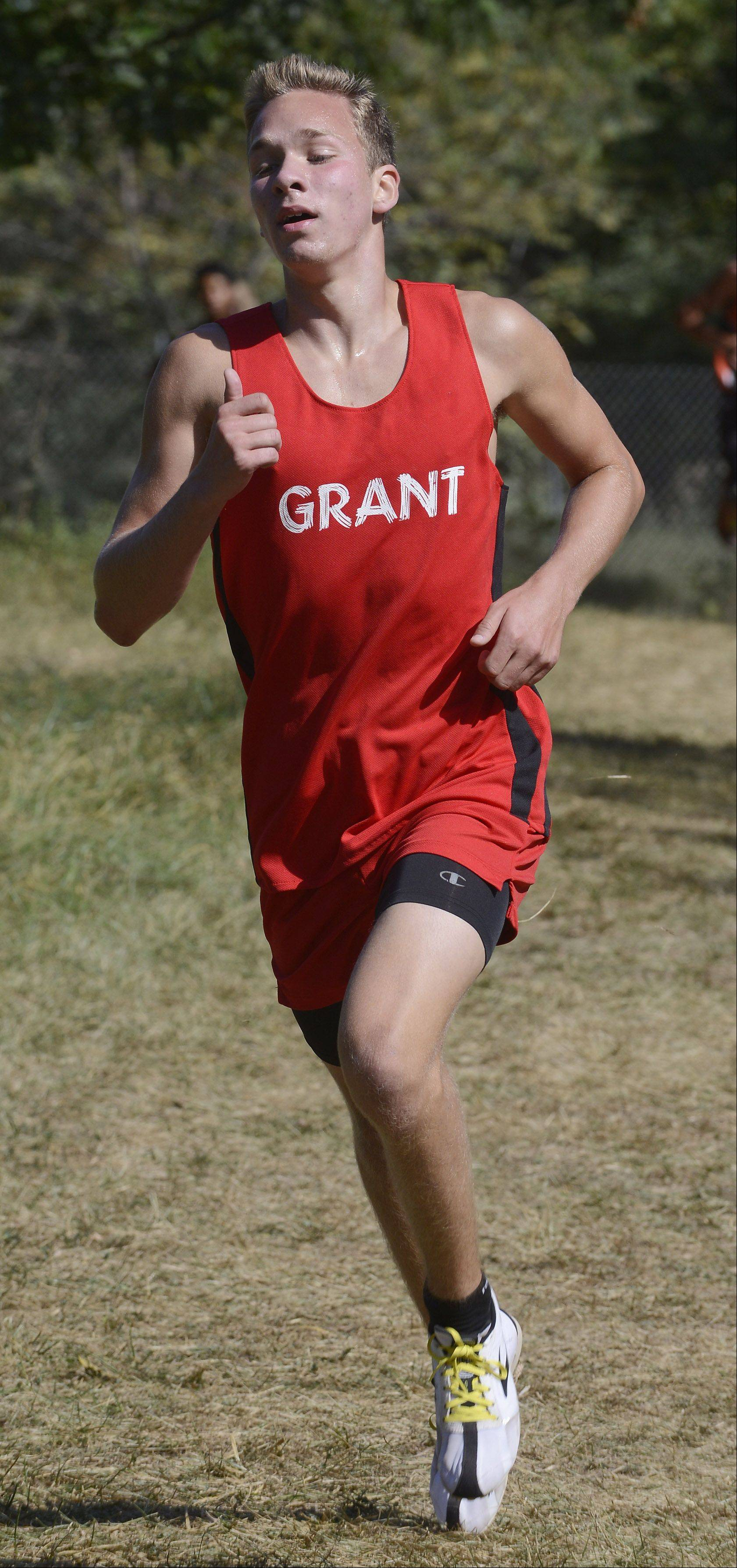 Grant's Dalyn Romig is on his way to a 10th-place finish during the Wauconda cross country invitational at Lakewood Forest Preserve on Saturday.
