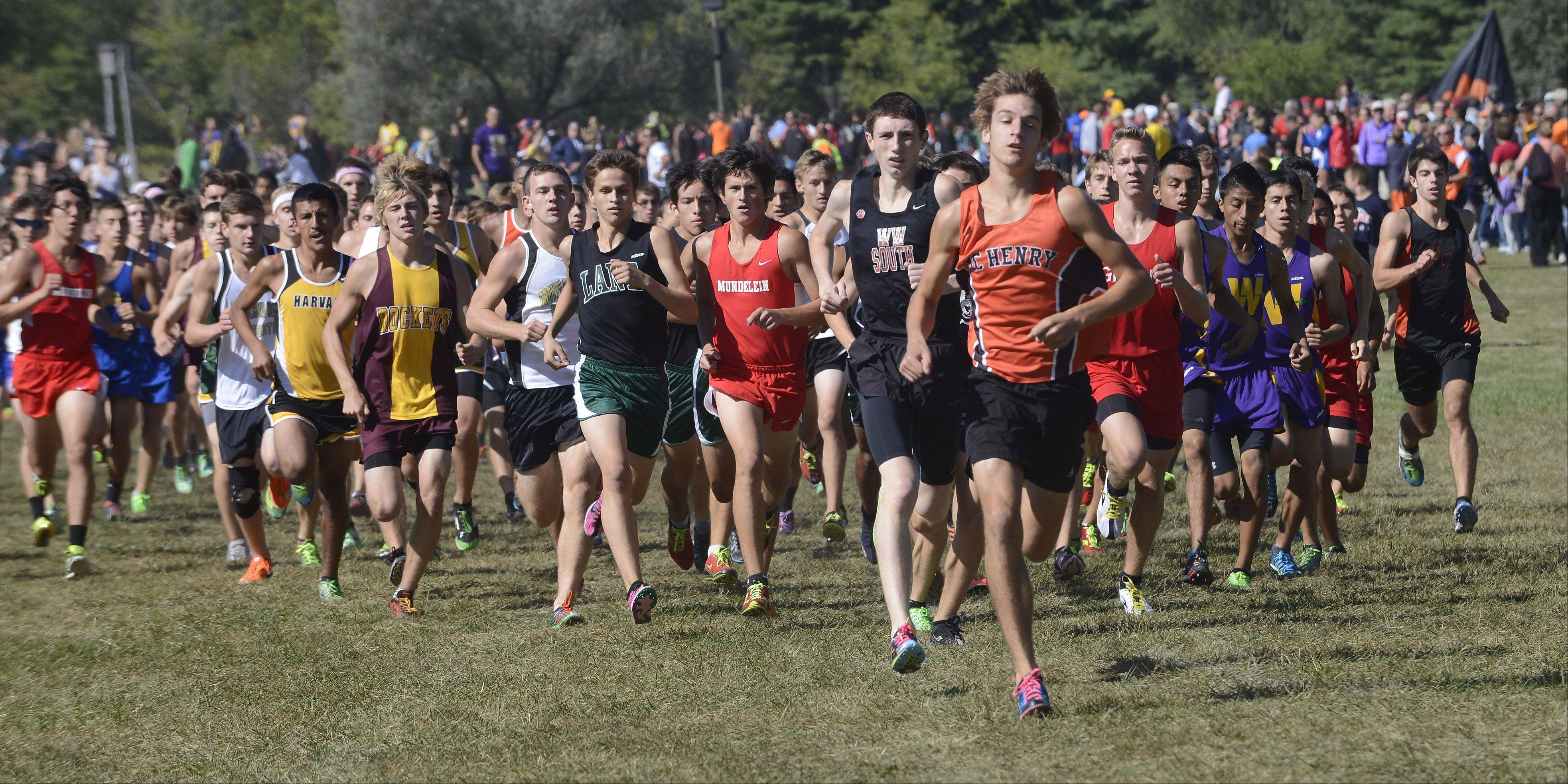McHenry's Jesse Reiser, who went on to finish first individually, leads the pack just after the start of the boys race during the Wauconda cross country invitational at Lakewood Forest Preserve on Saturday.