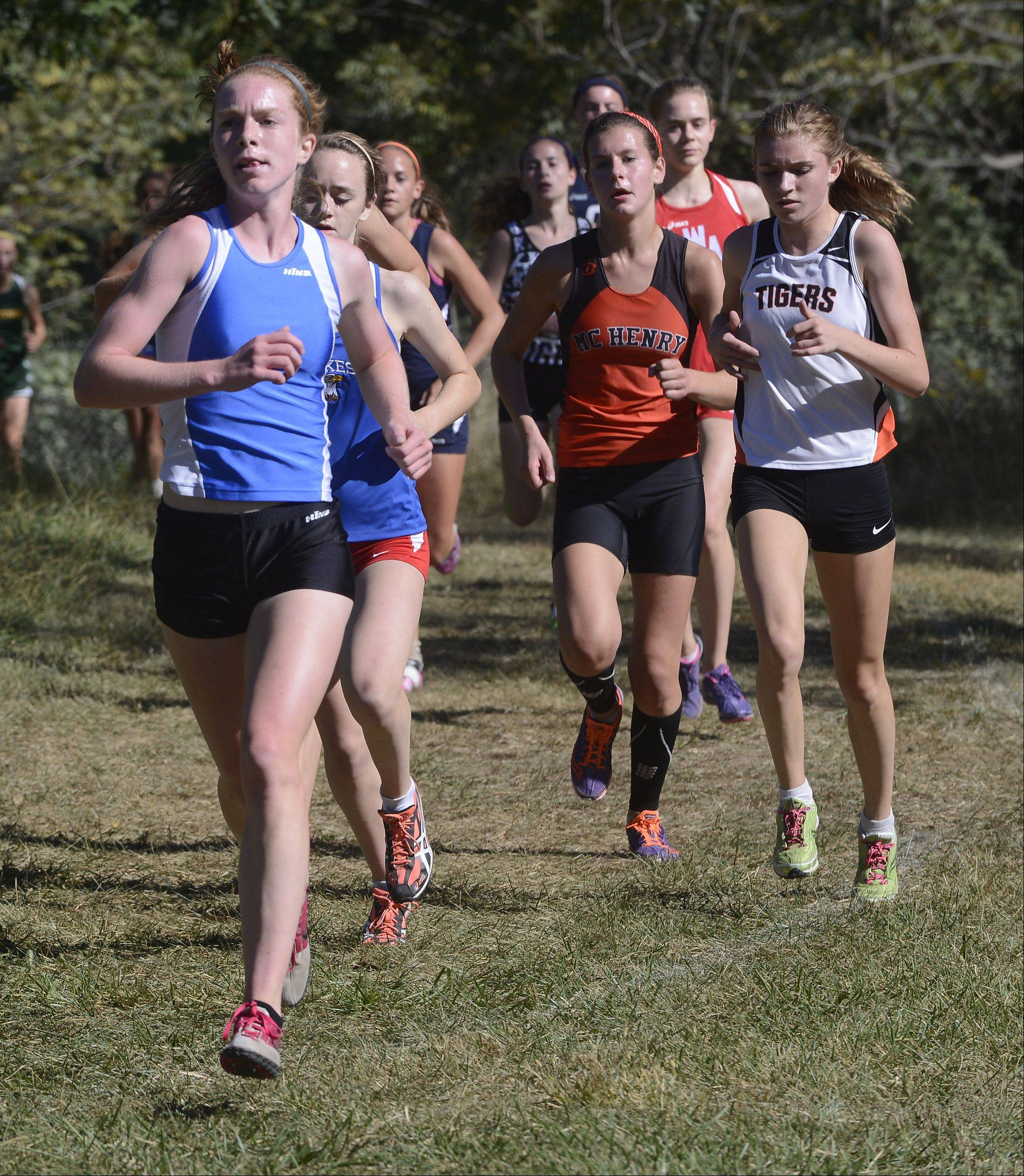 First-place finisher Meaghan Gelinas takes the lead during the Wauconda cross country invitational at Lakewood Forest Preserve on Saturday.