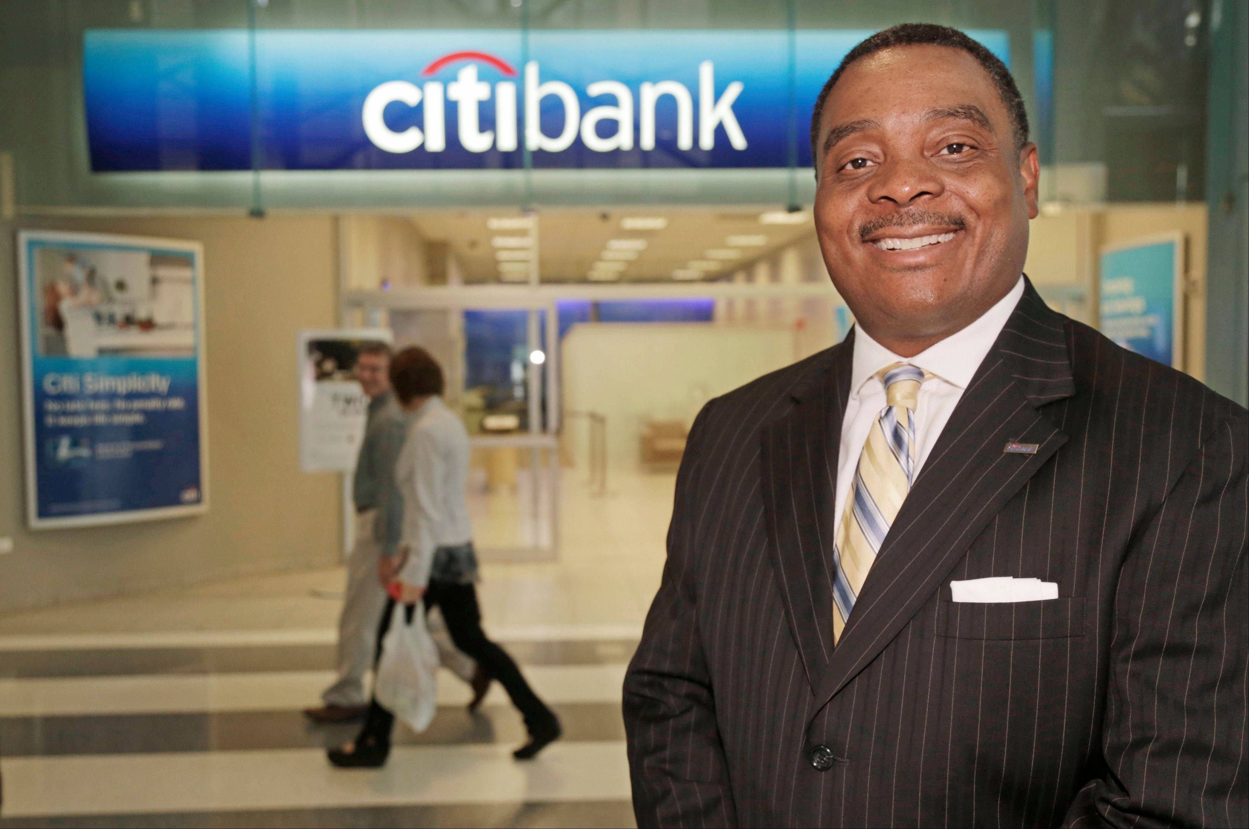 Jerome Byers, the head of small business banking at Citigroup poses in front of a downtown Chicago Citibank branch. Byers, a former small business owner himself, is working to change the impression that Citigroup caters to just big corporate and international clients.