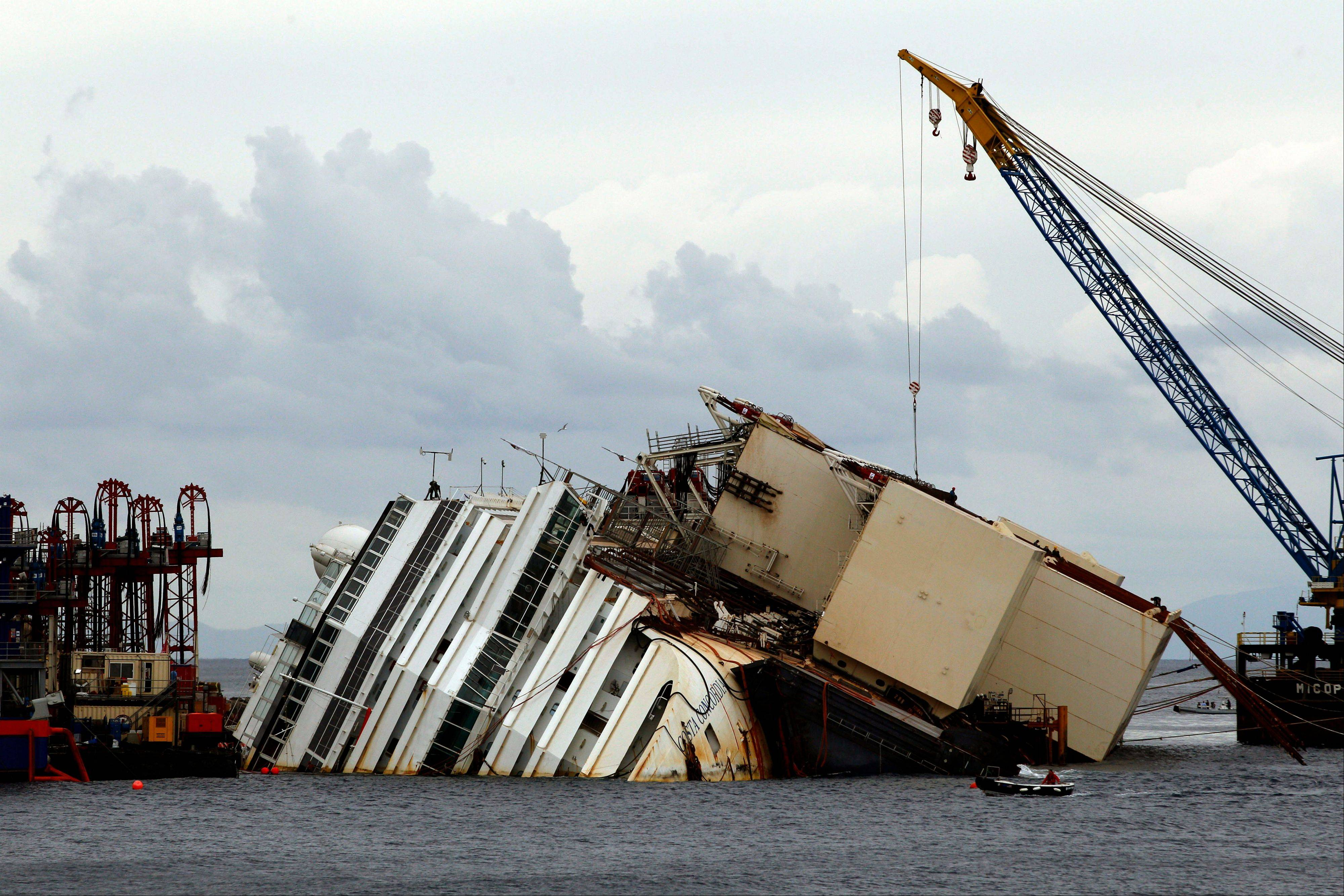 The Costa Concordia ship lies on its side on the Tuscan Island of Giglio, Italy, Sunday. Authorities have given the final go-ahead for a daring attempt today to pull upright the crippled cruise liner from its side, a make-or-break engineering feat that has never before been tried in such conditions.