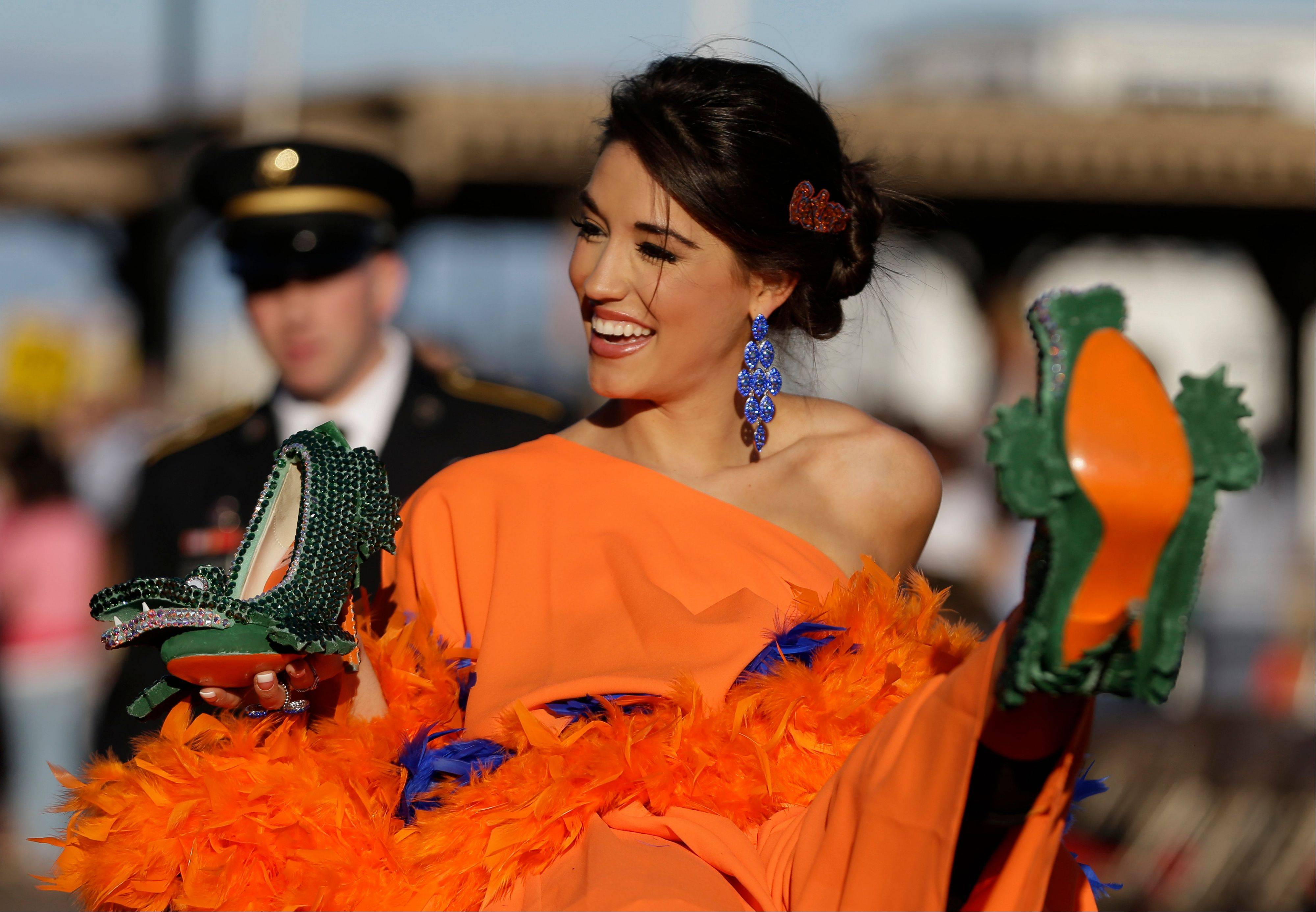 Miss Florida Myrrhanda Jones shows her shoe Saturday during the Miss America Shoe Parade at the Atlantic City boardwalk.