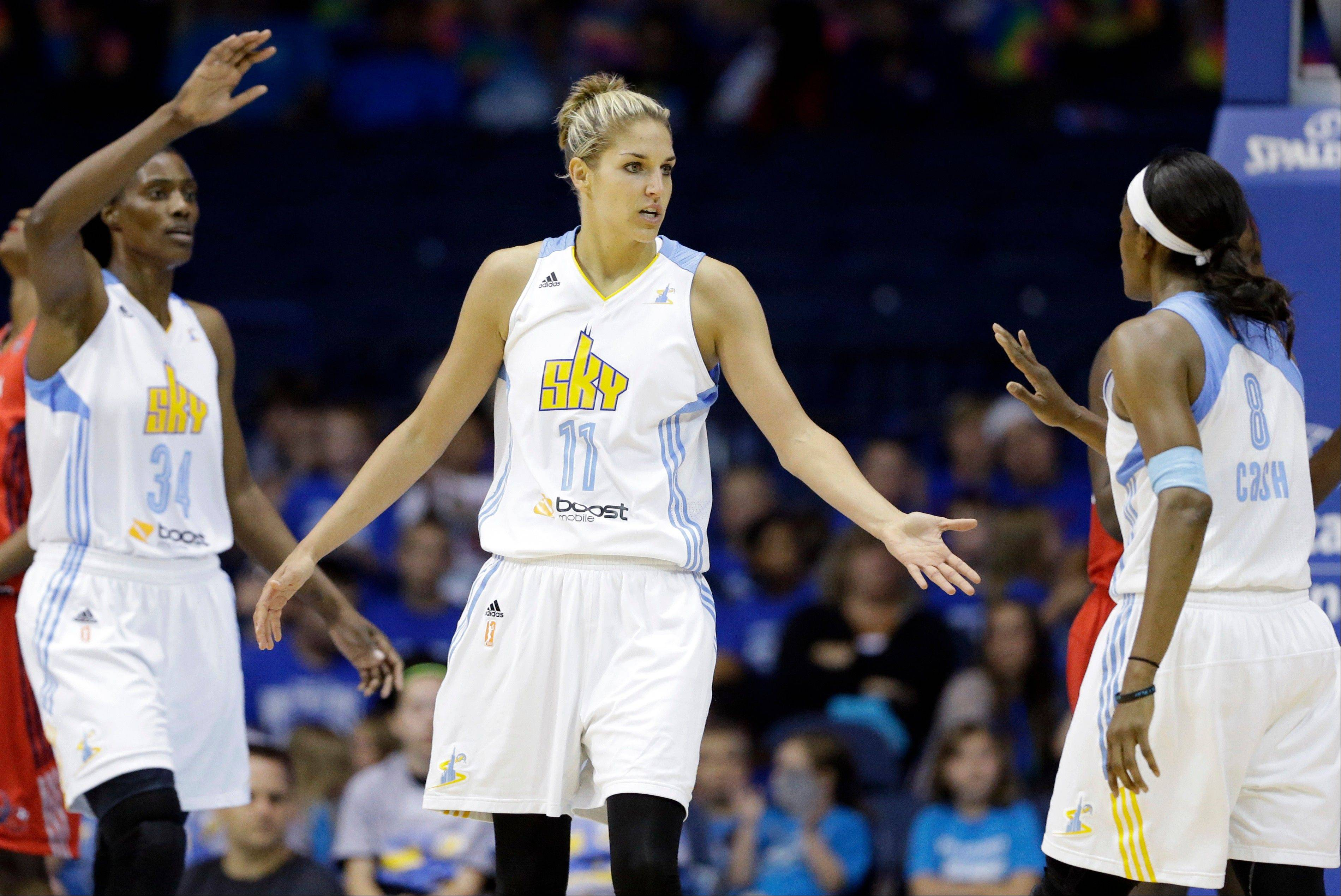 Chicago Sky forward Elena Delle Donne, center, credits forward Swin Cash, right, with helping her adjust to the WNBA. Delle Donne and Sylvia Fowles, left, have led the Sky to first place in the Eastern Conference.