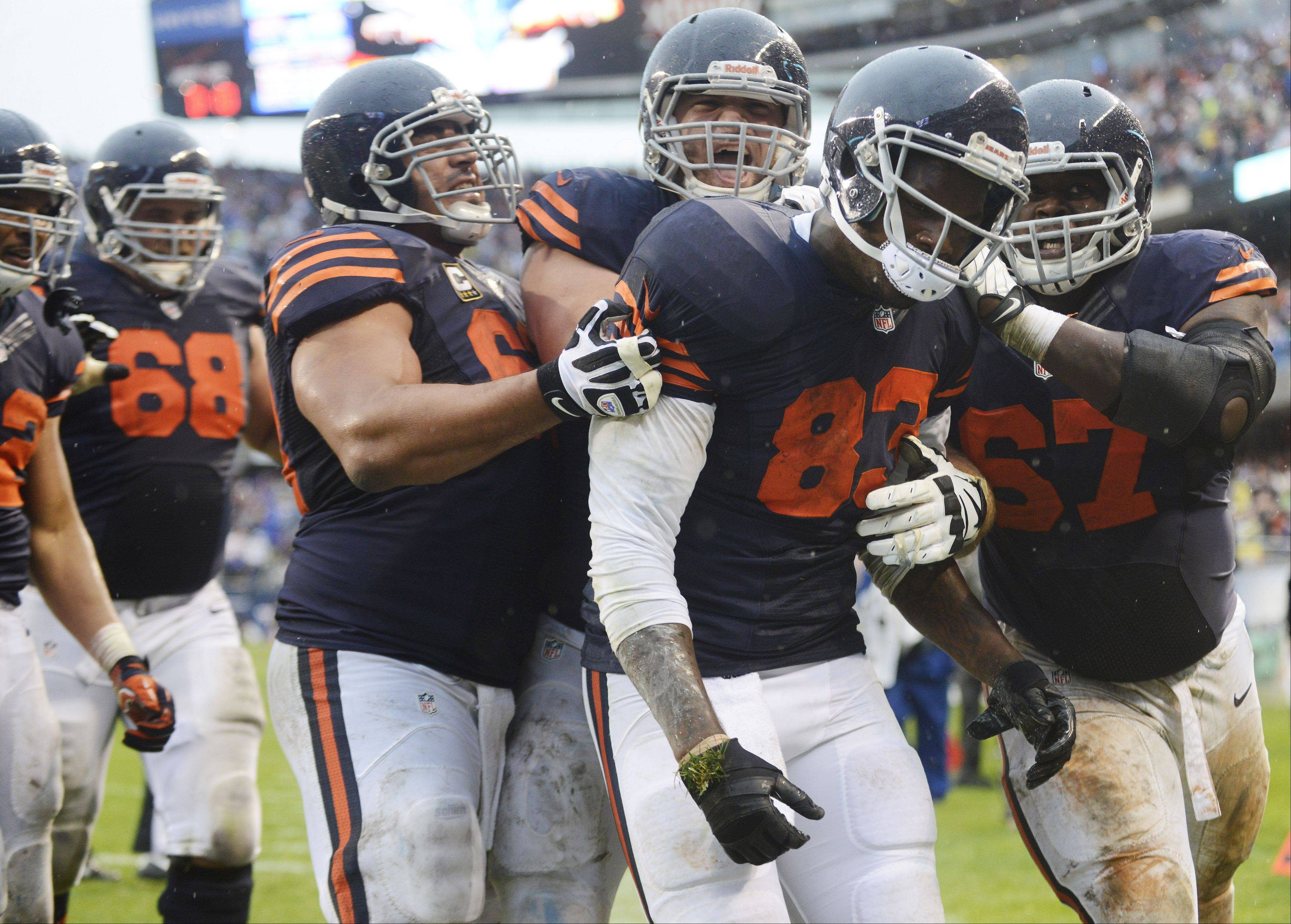 Chicago Bears tight end Martellus Bennett is mobbed by teammates after making a touchdown catch with 10 seconds left during Sunday�s game against the Minnesota Vikings at Soldier Field.