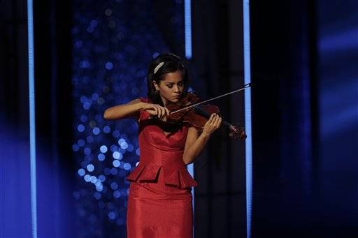 Miss Minnesota Rebecca Yeh performs during the Miss�America 2014 pageant, Sunday, Sept. 15, 2013, in Atlantic City, N.J.