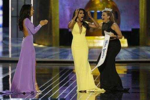 Miss New York Nina Davuluri, center, reacts after being named Miss America 2014 pageant as Miss California Crystal Lee, left, and Miss America 2013 Mallory Hagan celebrate with her, Sunday, Sept. 15, 2013, in Atlantic City, N.J.