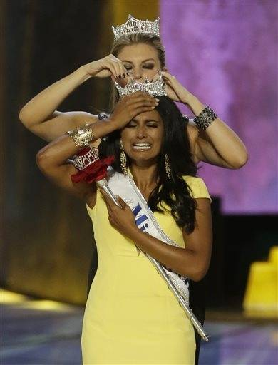 Miss New York Nina Davuluri, front, is crowned as Miss�America 2014 by Miss�America 2013 Mallory Hagan, Sunday, Sept. 15, 2013, in Atlantic City, N.J.