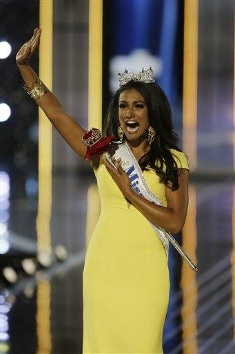 Miss New York Nina Davuluri walks down the runway after winning the the Miss�America 2014 pageant, Sunday, Sept. 15, 2013, in Atlantic City, N.J.