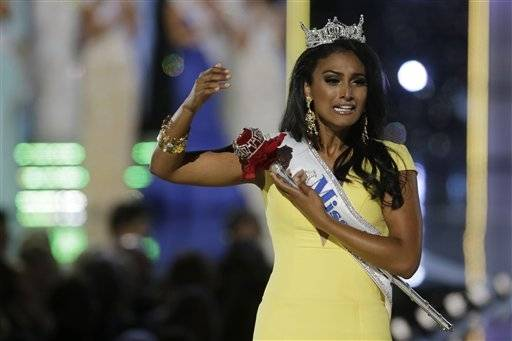 Miss New York Nina Davuluri begins her walk down the runway after winning the the Miss�America 2014 pageant, Sunday, Sept. 15, 2013, in Atlantic City, N.J.