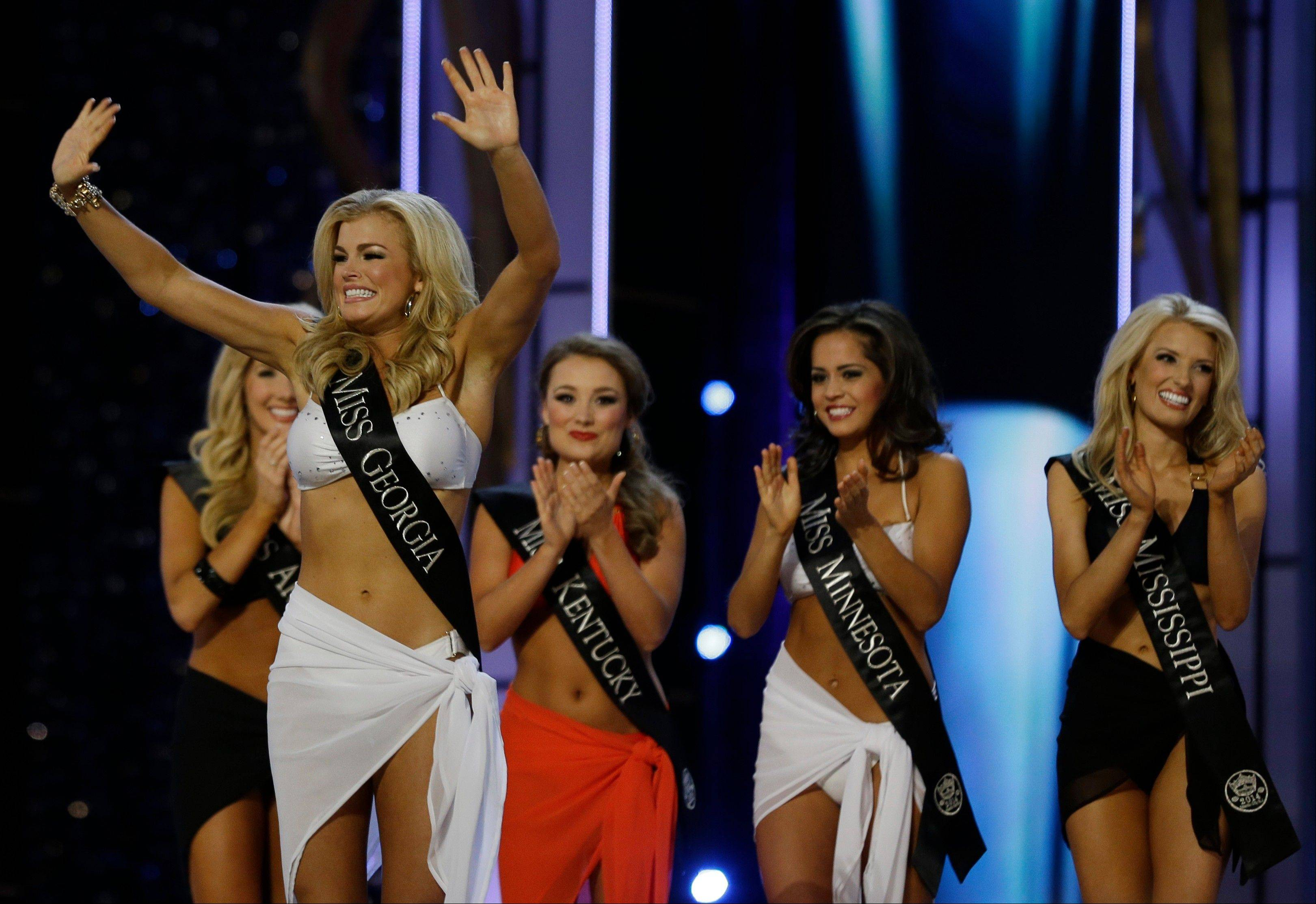 Miss Georgia Carly Mathis acknowledges the crowd after advancing beyond the lifestyle competition during the Miss America 2014 pageant, Sunday, Sept. 15, 2013, in Atlantic City, N.J.