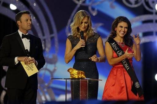 Miss Oklahoma Kelsey Griswold, right, reacts before answering a question during the Miss�America 2014 pageant, Sunday, Sept. 15, 2013, in Atlantic City, N.J.