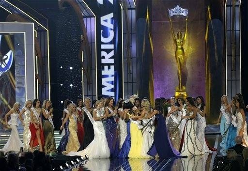 Miss New York Nina Davuluri, center left in yellow, is approached by contestants after Davuluri was crowned as Miss�America 2014, Sunday, Sept. 15, 2013, in Atlantic City, N.J.