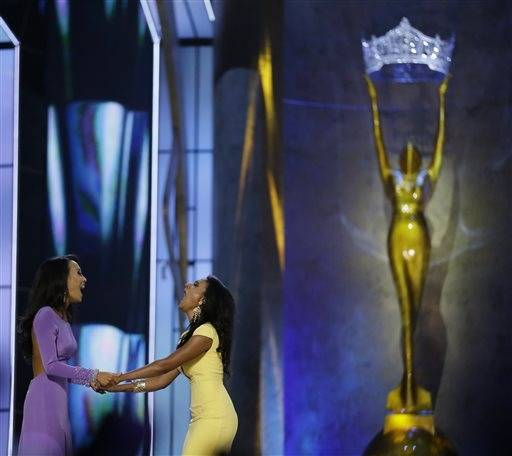 Miss New York Nina Davuluri, right, reacts with Miss California Crystal Lee after Davuluri won Miss�America 2014 pageant, Sunday, Sept. 15, 2013, in Atlantic City, N.J.