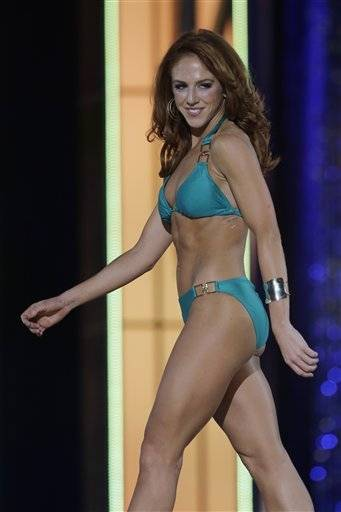Miss Connecticut Kaitlyn Tarpey displays her swimsuit during the Miss America 2014 pageant, Sunday, Sept. 15, 2013, in Atlantic City, N.J.