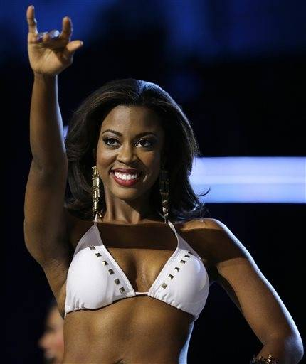 Miss Texas Ivana Hall gestures the longhorns with her fingers during the Miss�America 2014 pageant, Sunday, Sept. 15, 2013, in Atlantic City, N.J.