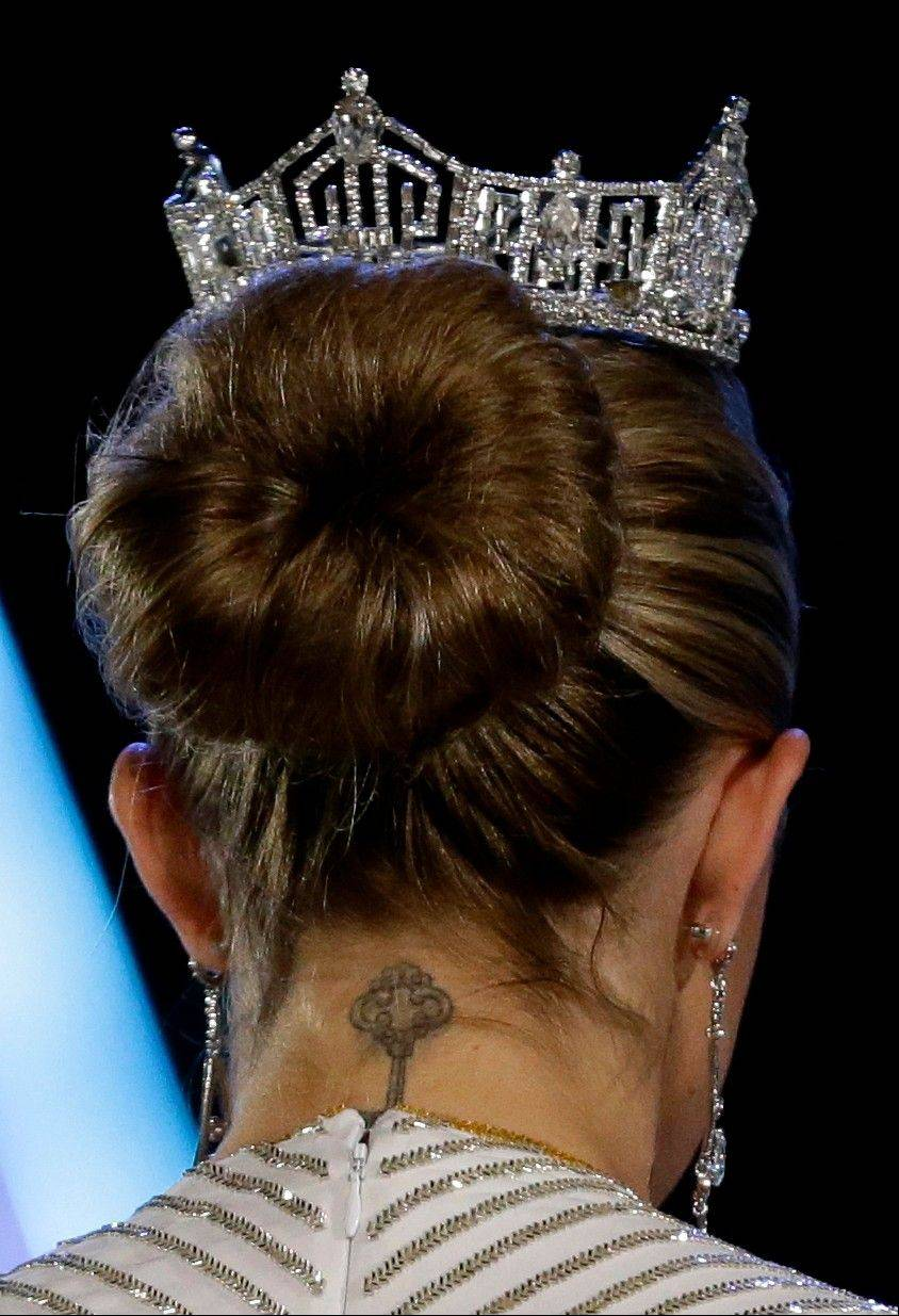A tattoo is seen on the neck of Miss America 2013 Mallory Hagan during the Miss America 2014 pageant, Sunday, Sept. 15, 2013, in Atlantic City, N.J.