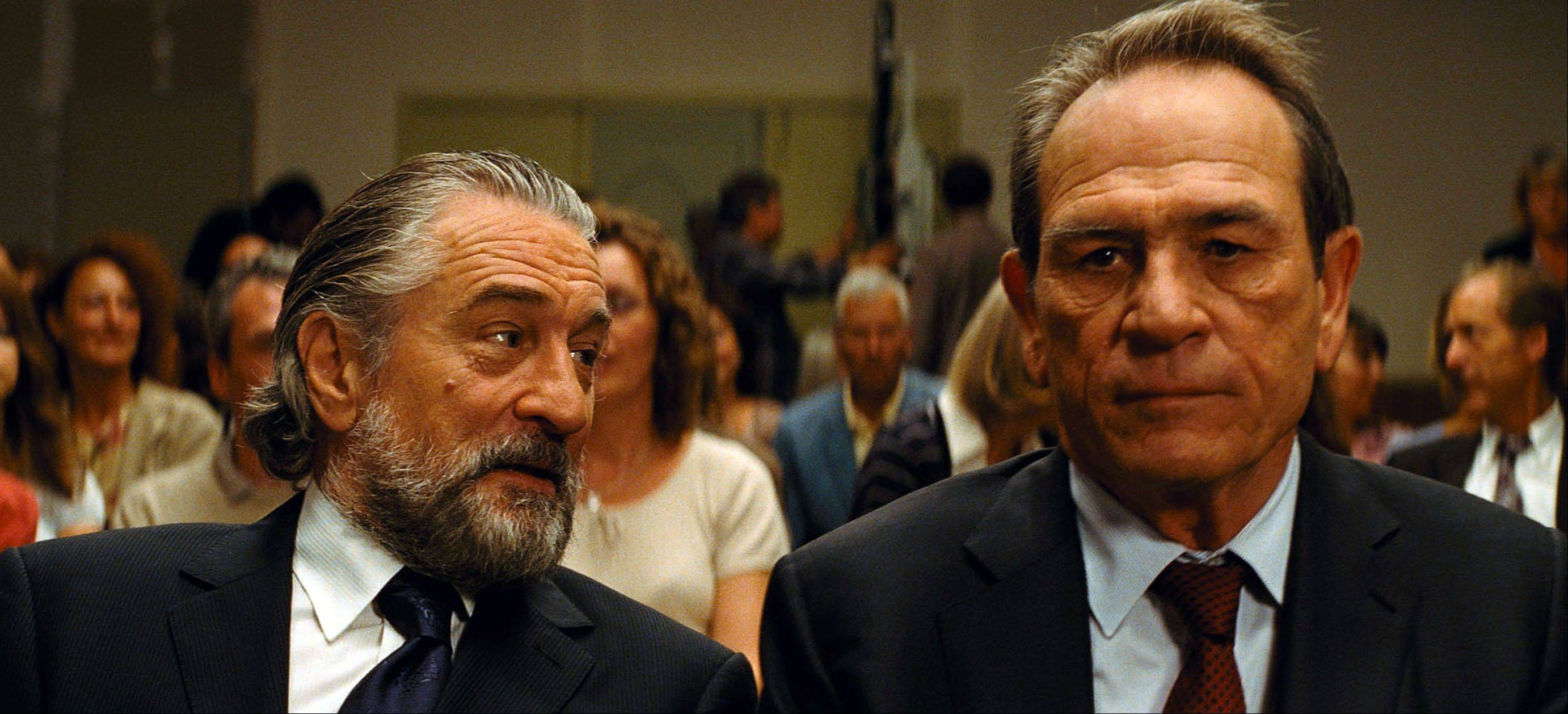 "This film publicity image released by Relativity Media shows Robert DeNiro, left, and Tommy Lee Jones in ""The Family,"" which debuted at No. 2 with a $14.5 million box office haul."
