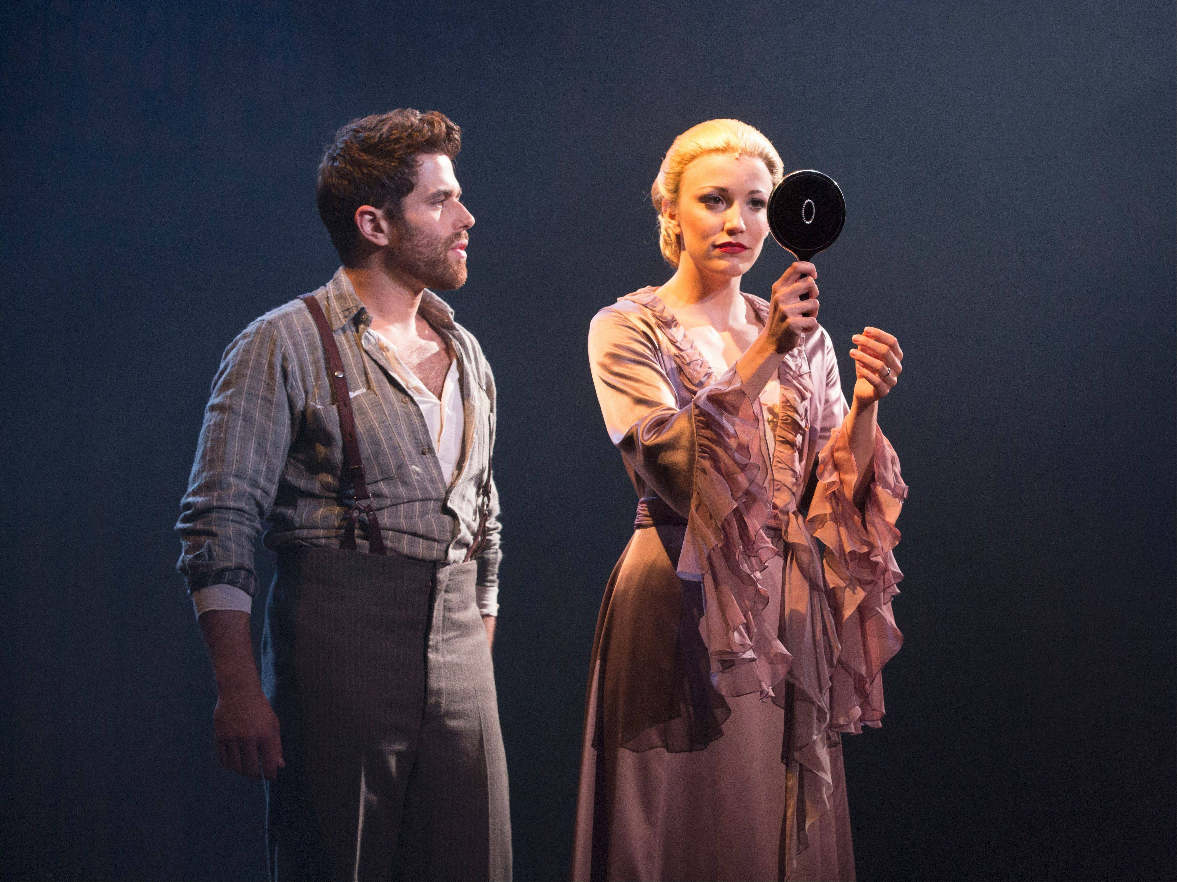 "Che (Josh Young) confronts Eva Peron (Caroline Bowman) in the new national tour of Andrew Lloyd Webber's and Tim Rice's musical ""Evita,"" which plays the Oriental Theatre in Chicago from Wednesday, Sept. 18, through Sunday, Oct. 6."