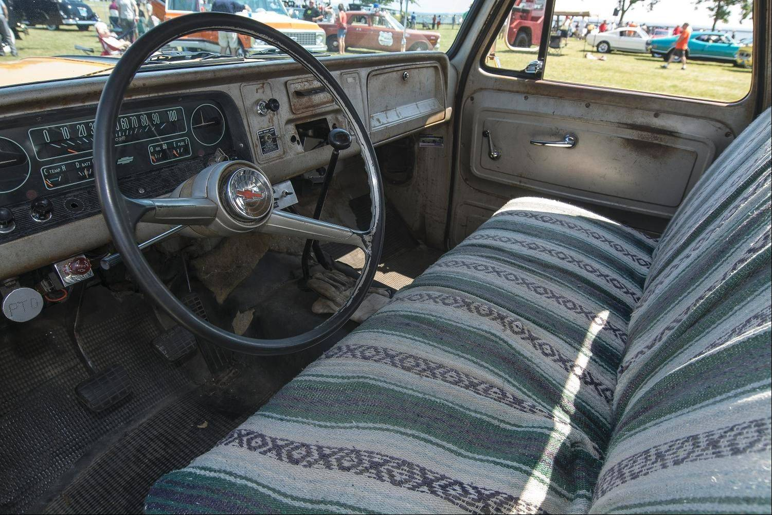 The interior upholstery has been replaced, but the rest of the cab is in its well-worn, original condition.