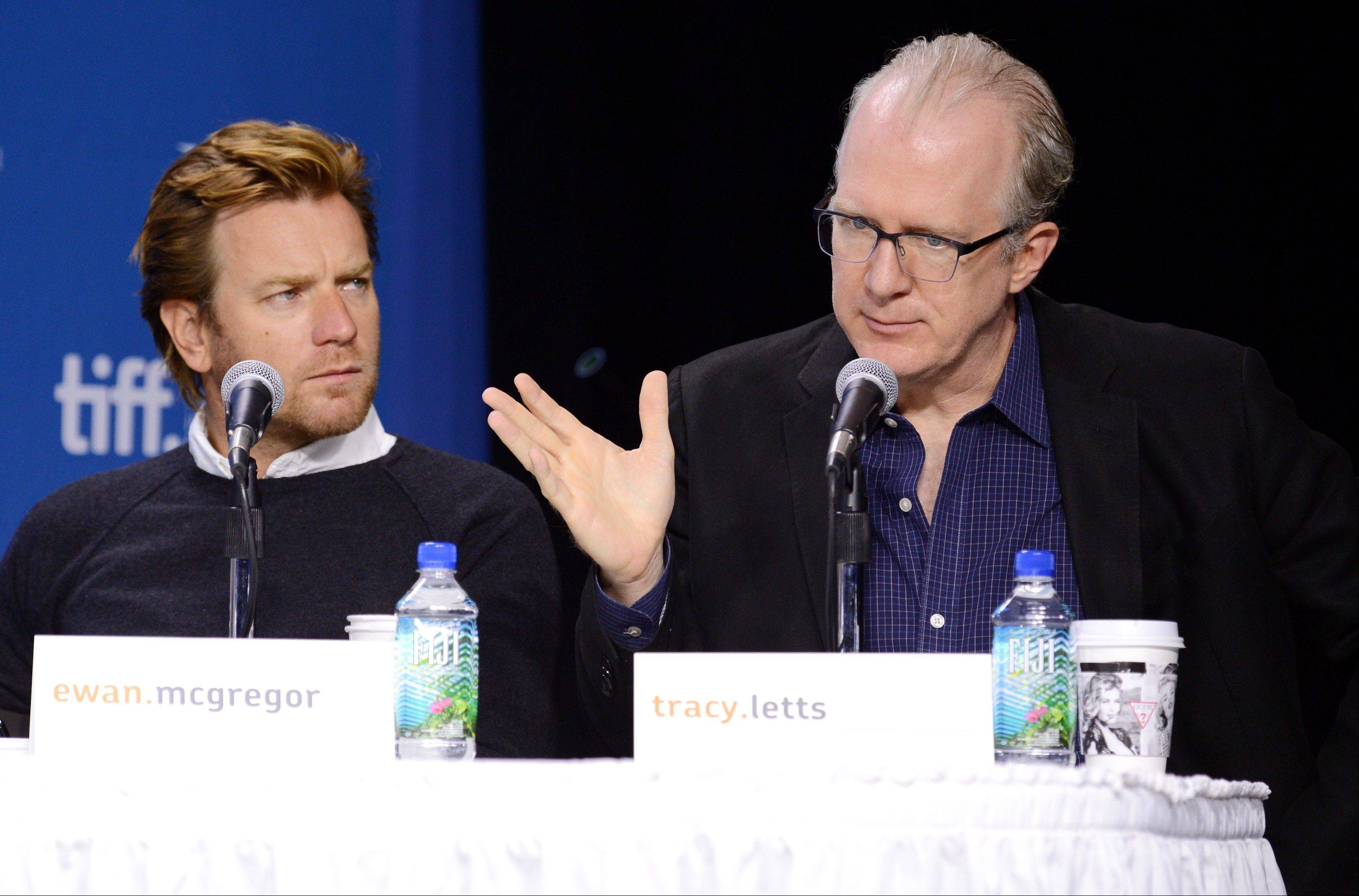"Writer Tracy Letts, right, and actor Ewan McGregor attend the news conference for ""August: Osage County"" at the 2013 Toronto International Film Festival."