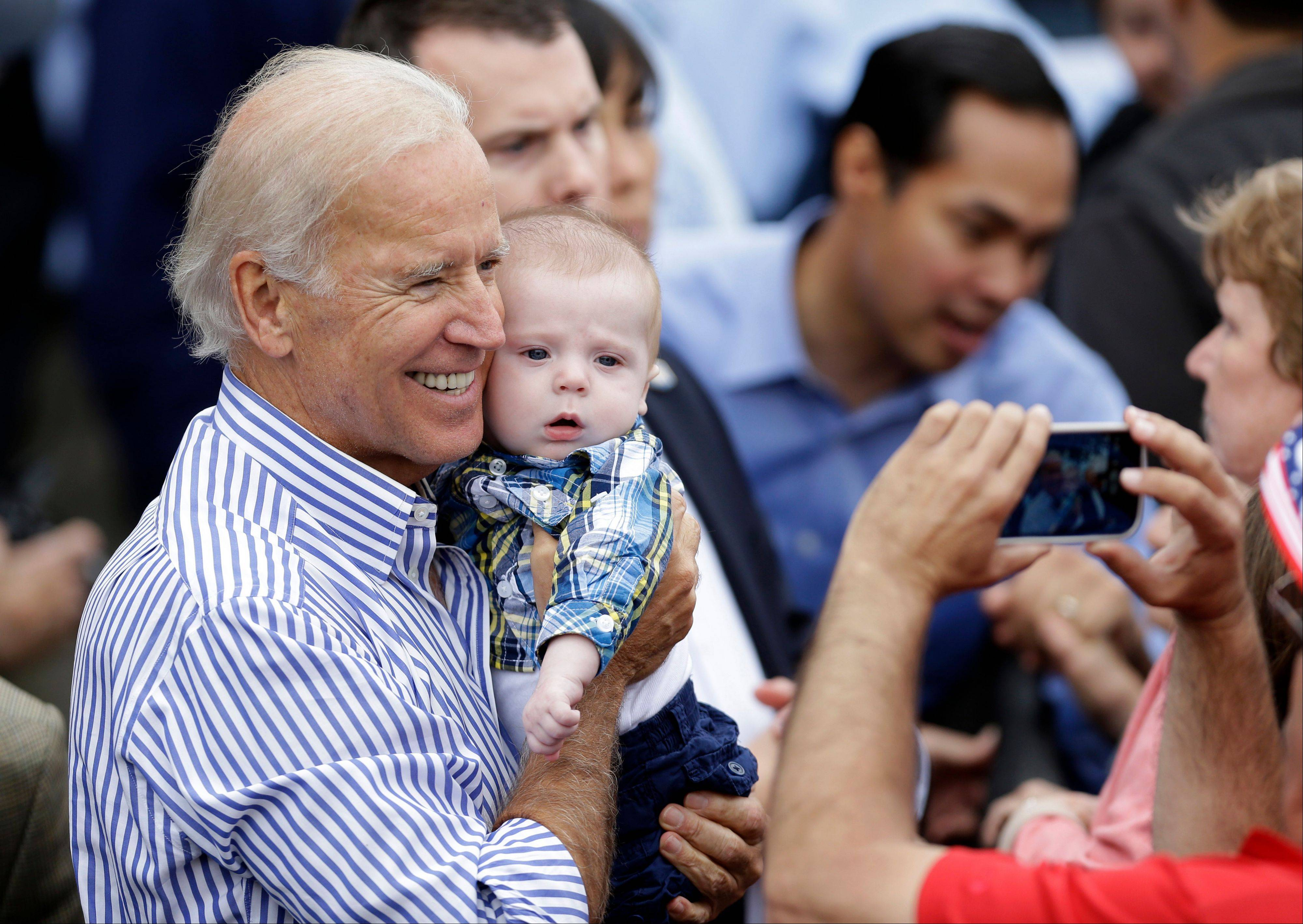 Vice President Joe Biden poses with a 5-month-old boy after speaking at Iowa Sen. Tom Harkin's annual fundraising steak fry dinner Sunday in Indianola, Iowa.