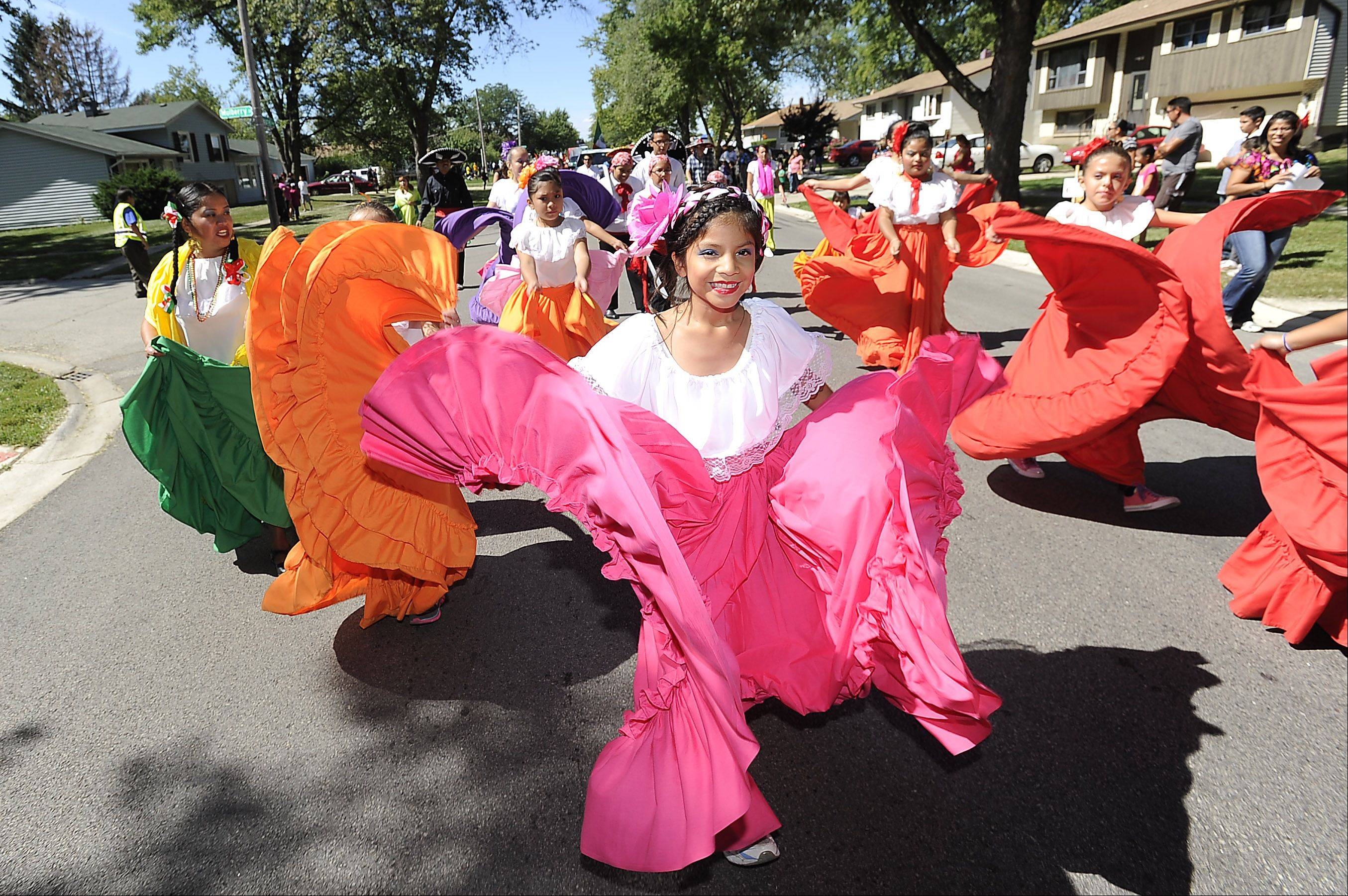 Daniela Contreras, 8, of Addison, dances in the streets of Hanover Park in the second annual Mexican Independence parade on Saturday.
