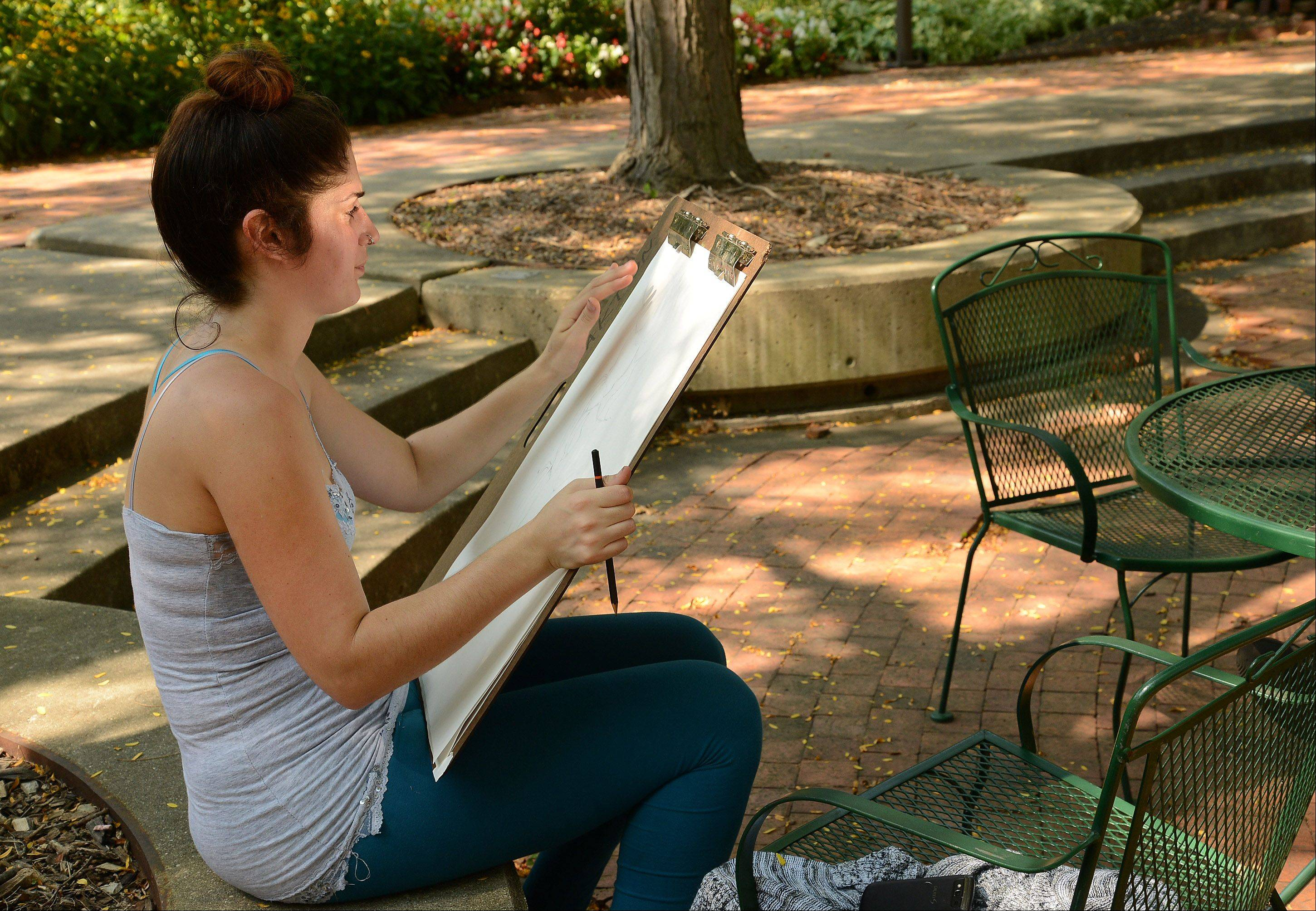 Art student Zulema Dorado, sketches outside for her Advance Drawing class at Oakton Community College in Des Plaines.