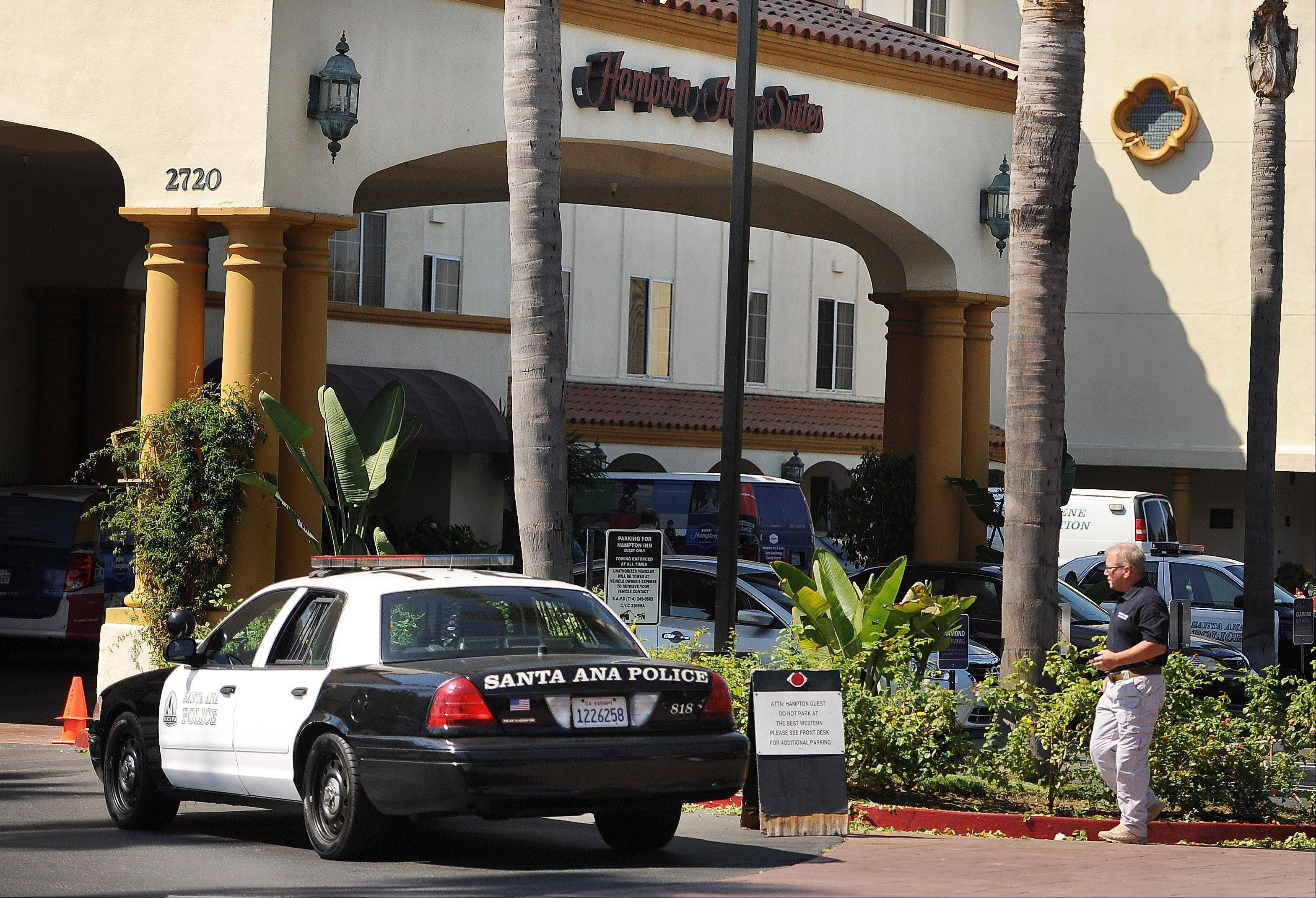 Two children were killed at the Hampton Inn Suites on Grand and Dyer in Santa Ana said Anthony Bertagn, with the Santa Ana Police Department. The mother of the children allegedly tried to commit suicide by ramming her car into a utility box behind a shopping center in Costa Mesa, Calif., Saturday Sept. 14, 2013.