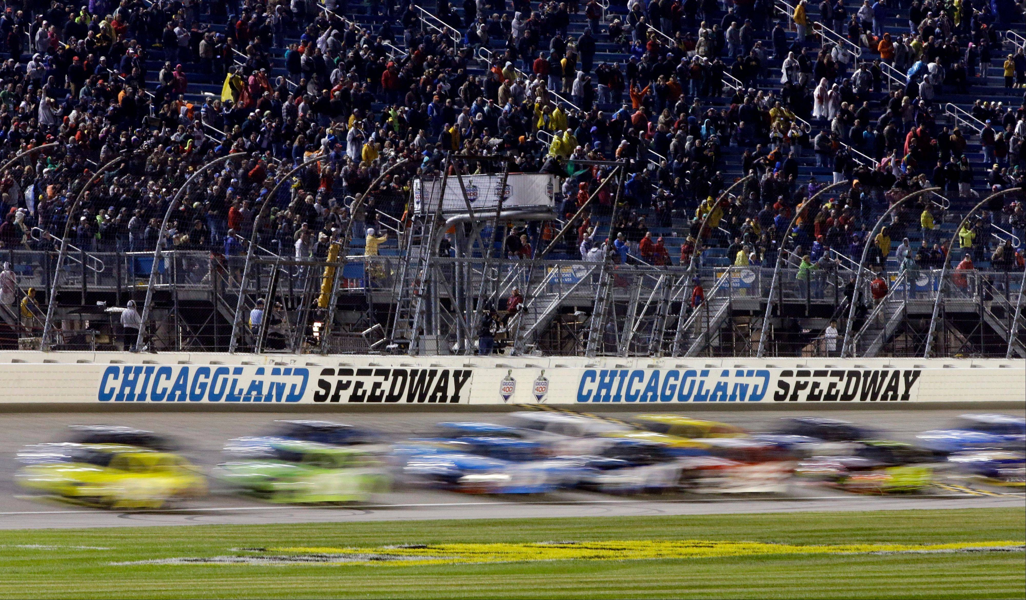 Drivers restart after being rain delayed during the NASCAR Sprint Cup series auto race at Chicagoland Speedway in Joliet, Ill., Sunday, Sept. 15, 2013.